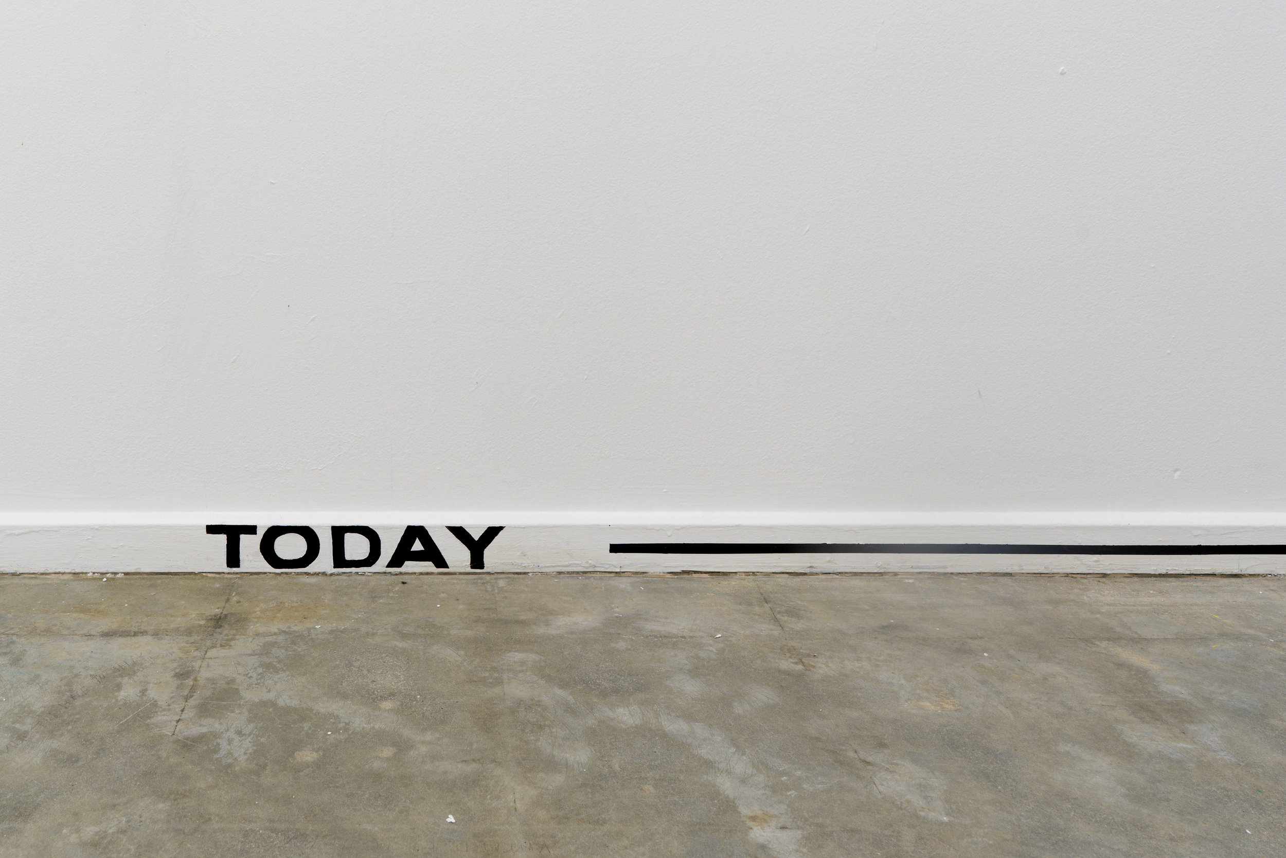 WE ARE GATHERED HERE        TODAY , black painted text and line on the gallery skirting boards, in  Who speaks for a community?  curated by Bella Hone-Saunders, Sister Gallery, 2017.