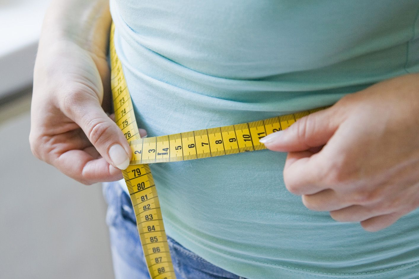 measuring-waist-GettyImages-84057051-58078ea33df78cbc2840c4c5.jpg