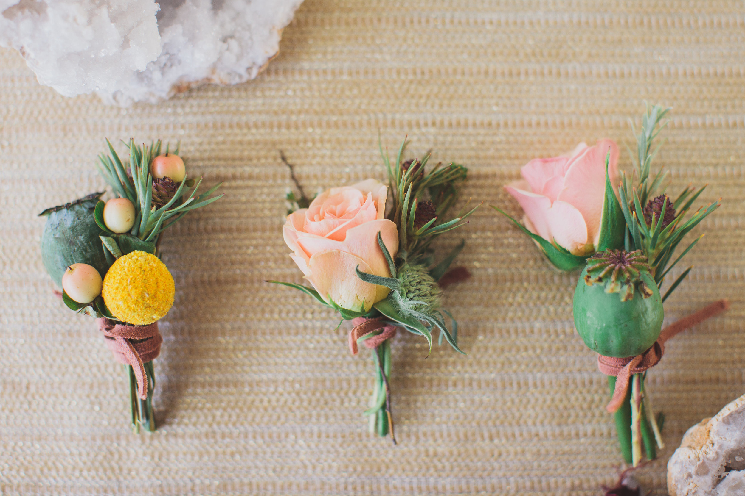 I adore these fun boho inspired boutonnieres with plenty of texture and a casual leather wrap.