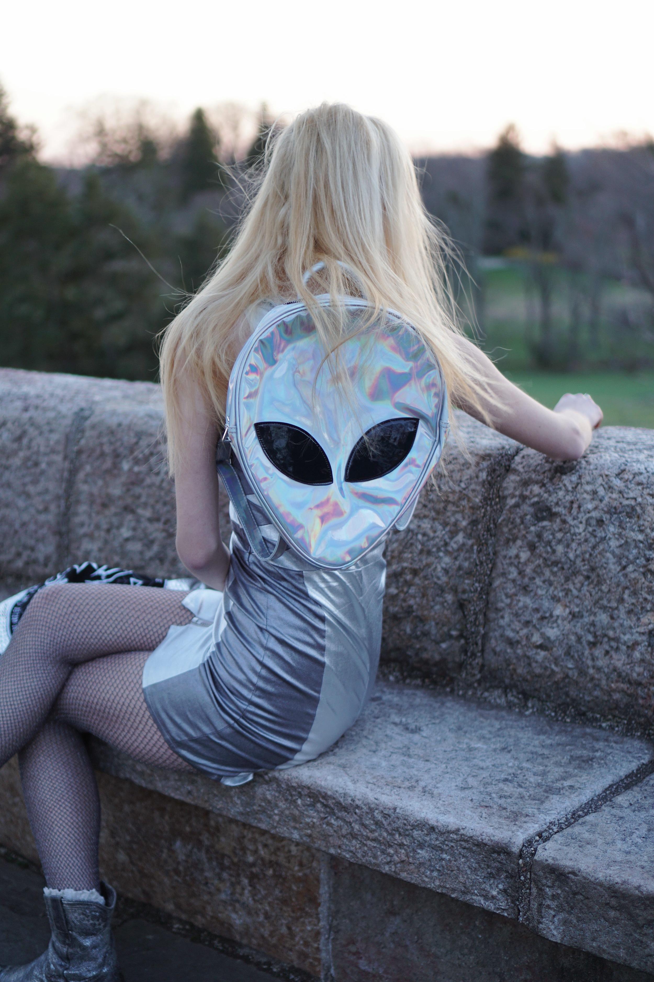 dress:   disturbia   | bomber jacket:   disturbia   | holographic backpack:   disturbia   | alien ring:   disturbia   | boots:  free people  | socks:   free people