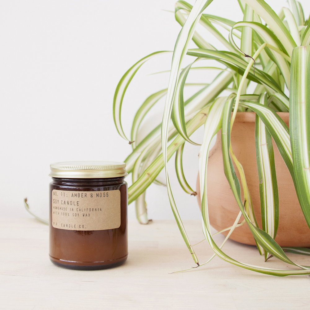 AMBER & MOSS CANDLE  : $18   PERFECT FOR : Yourself, honestly. But also anyone who likes things to smell nice. Soy wax and a 40 hour burn time.   P.F. Candle Co. .