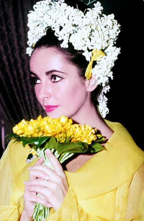 Elizabeth Taylor at her second wedding with Richard Burton in a trend  setting yellow