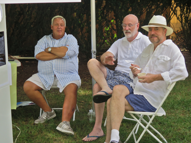 Kevin Kerr, president of the board, left, relaxes after a full weekend along with Michael Kennedy and Jack Burris. They were operating a photo booth, Greek style, at the Saturday dedication.