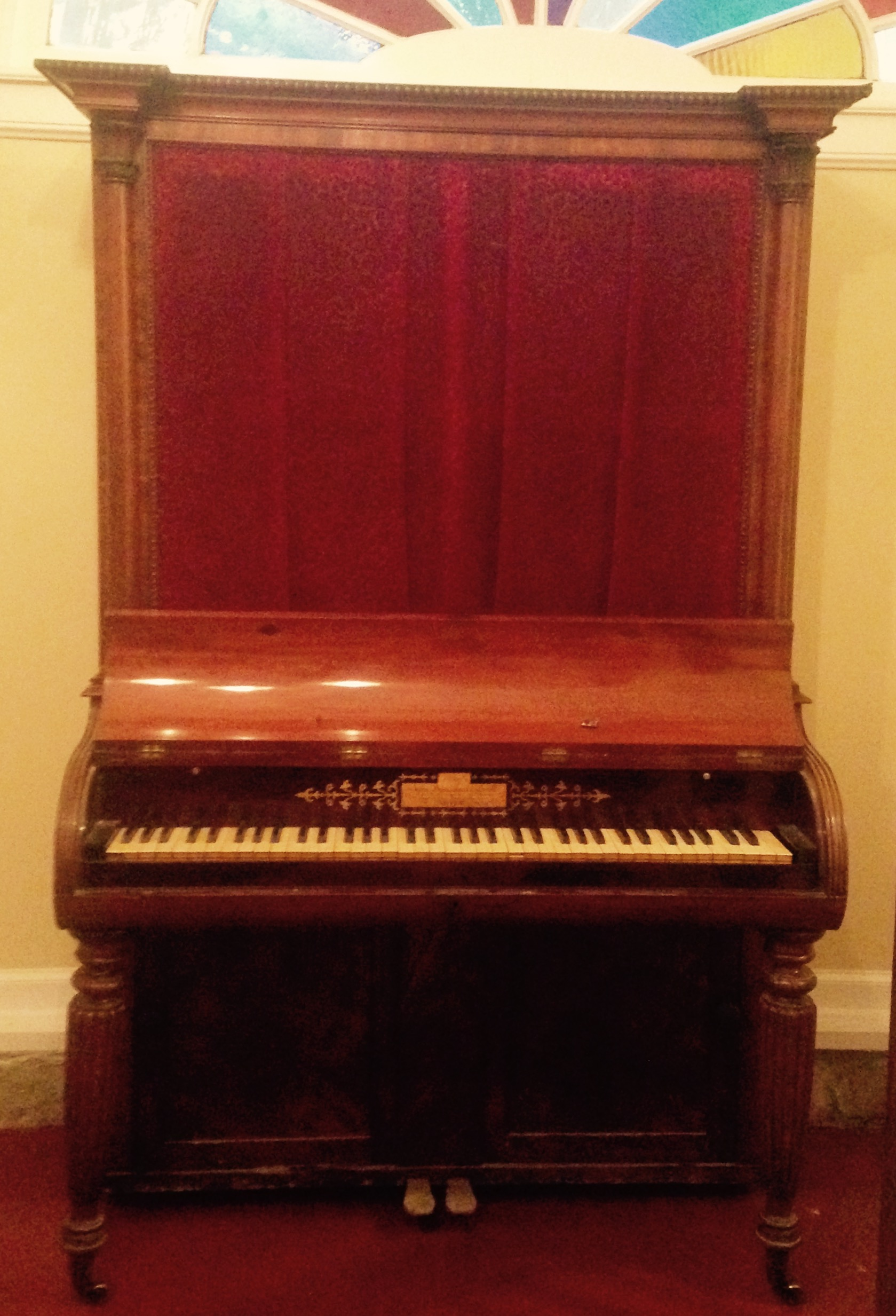 Full view of the piano. Note Empire style legs and trim.