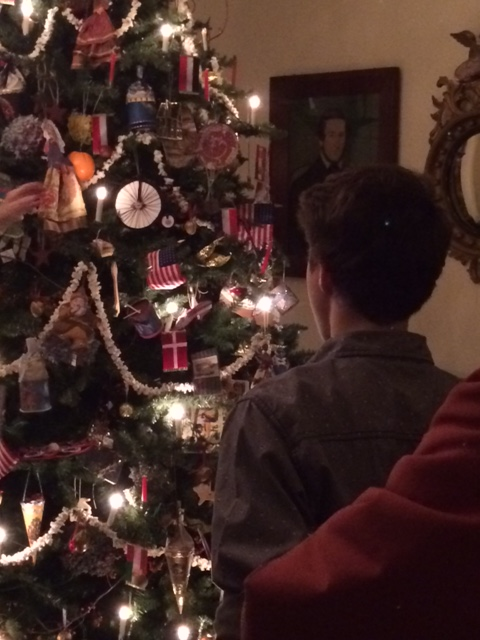 A young boy admires the tree in the main parlor of the Robbins Hunter Museum during a Night Before Christmas event.
