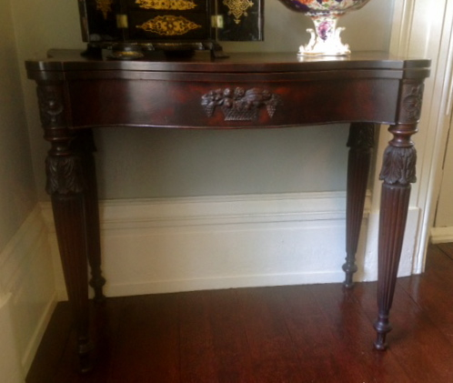 McIntire Table:  One of a pair of mahogany card tables attributed to Samuel McIntire.  Collection of Robbins Hunter Museum.