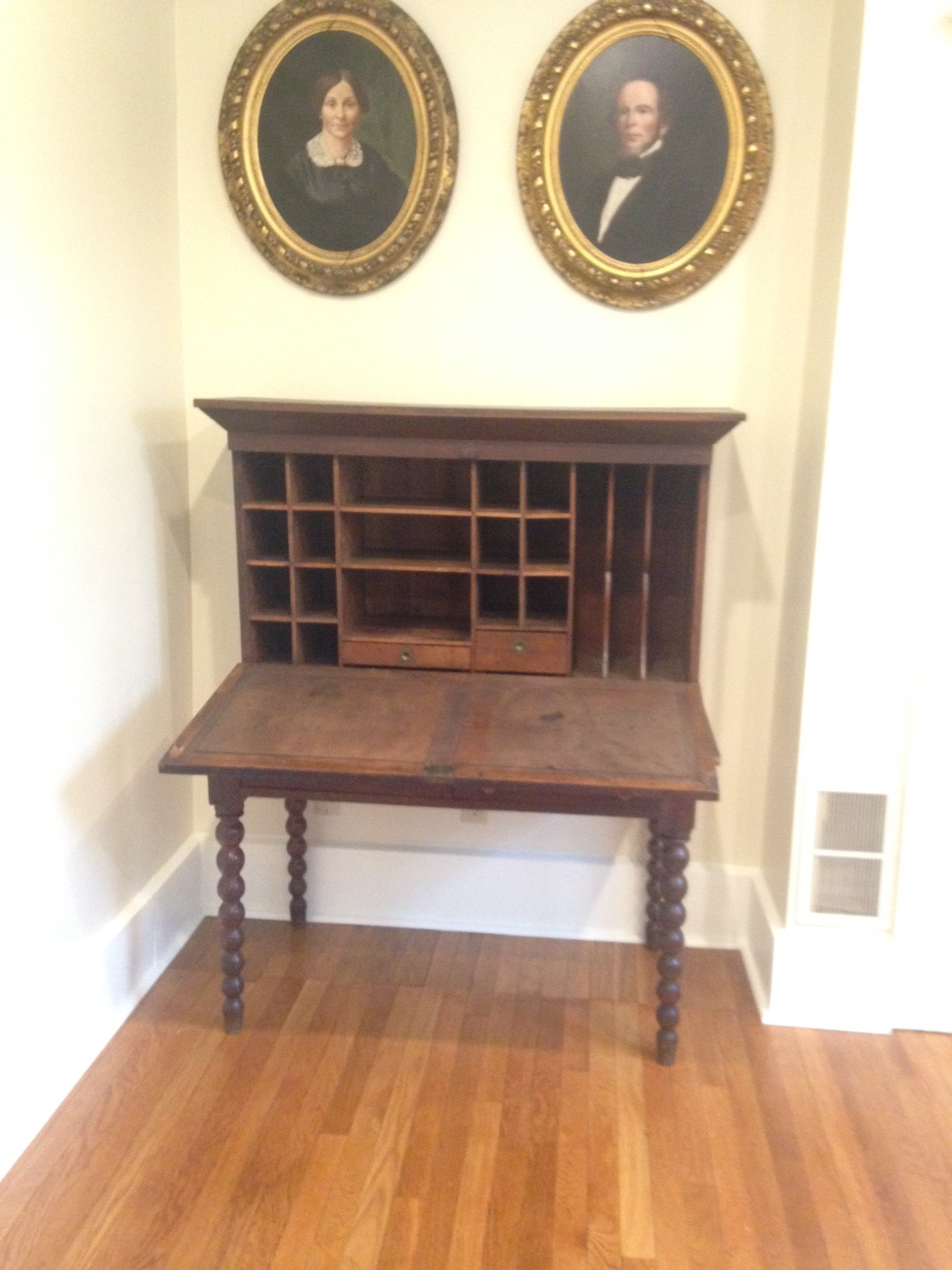 According to Robbins Hunter, Jr., this walnut desk, c. 1840, was used by Luke Warner in his office on the Ohio Canal in Newark.  Pictured above the desk are Luke and his wife Sarah, c. 1860.
