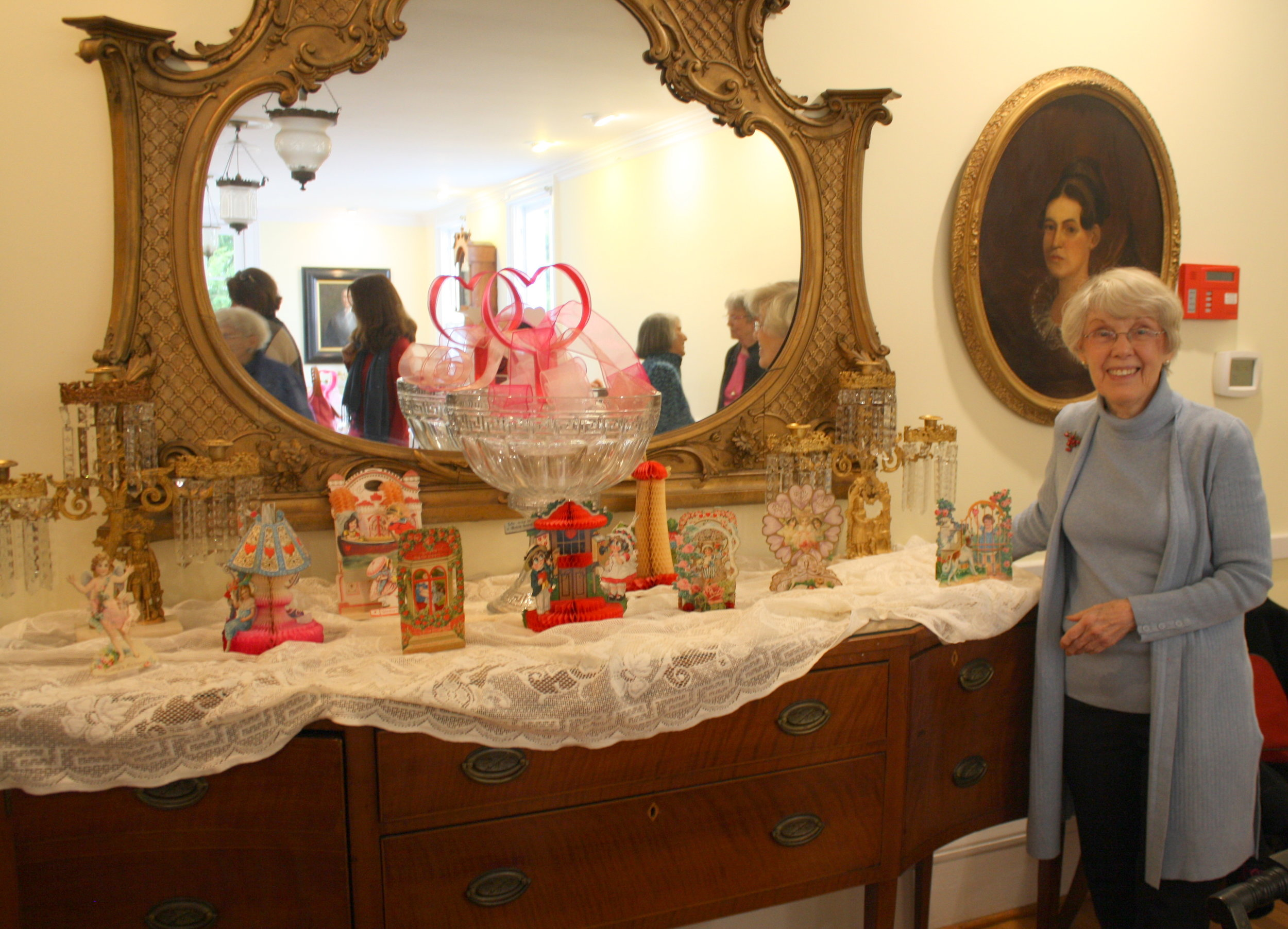 Rebecca Dungan and her collection of antique valentine cards at the Robbins Hunter Museum.