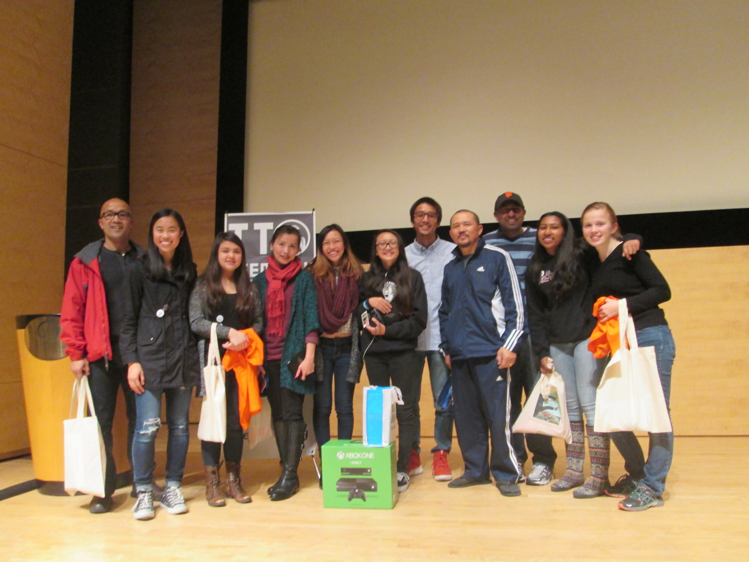 Winning Team photo with prizes from Microsoft, Friends of the SF Public Library, and the International School of the Peninsula