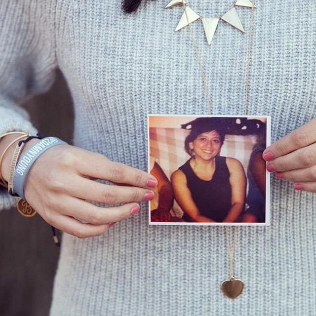 Vivian Nunez holding a picture of her mom, Delia