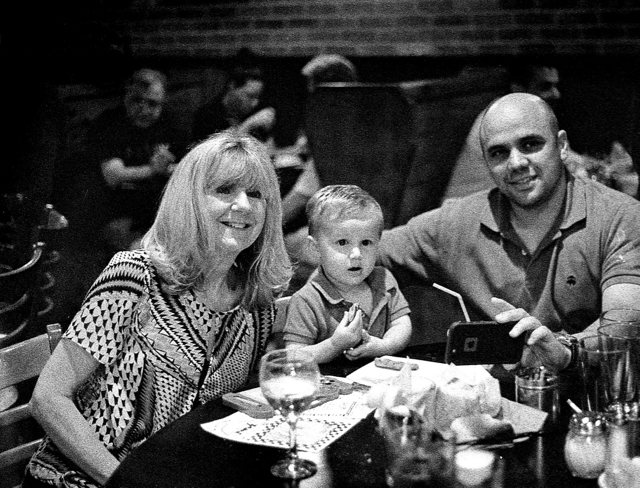 Julie with her grandson Ray and his dad, Jim, at dinner on our cruise from this past April.
