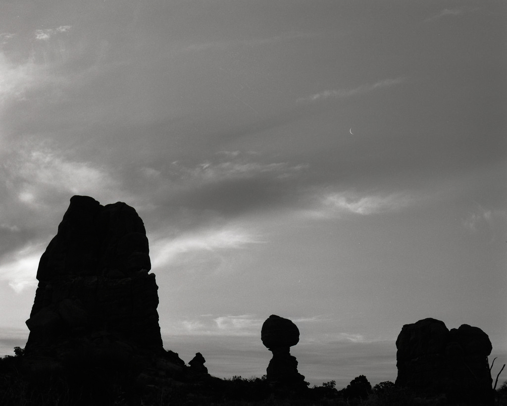 Evening in Arches National Park. Silhouette of Balanced Rock.