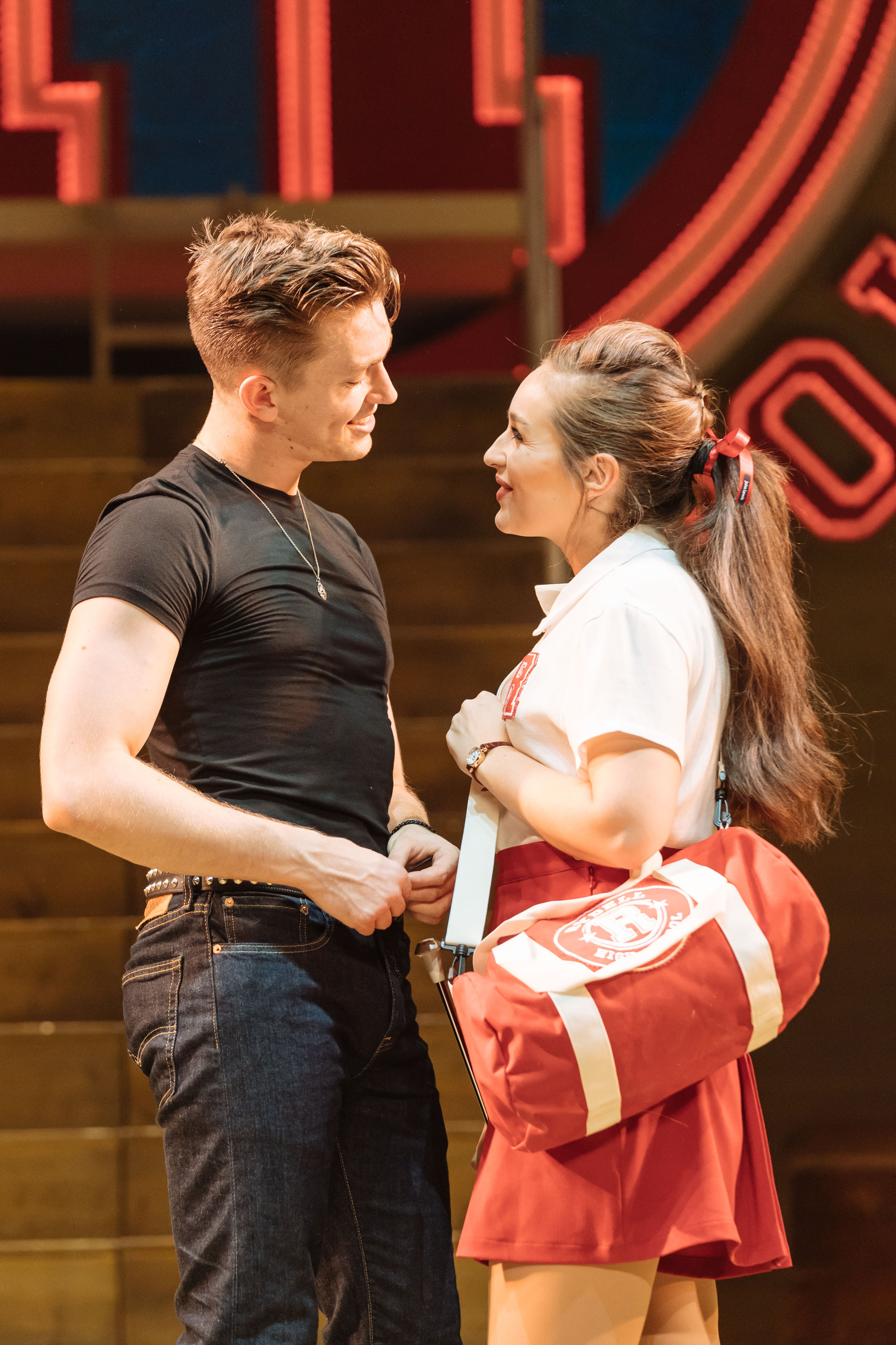 Dan Partridge as Danny and Martha Kirby as Sandy in the UK and Ireland tour of GREASE, credit Manuel Harlan.jpg