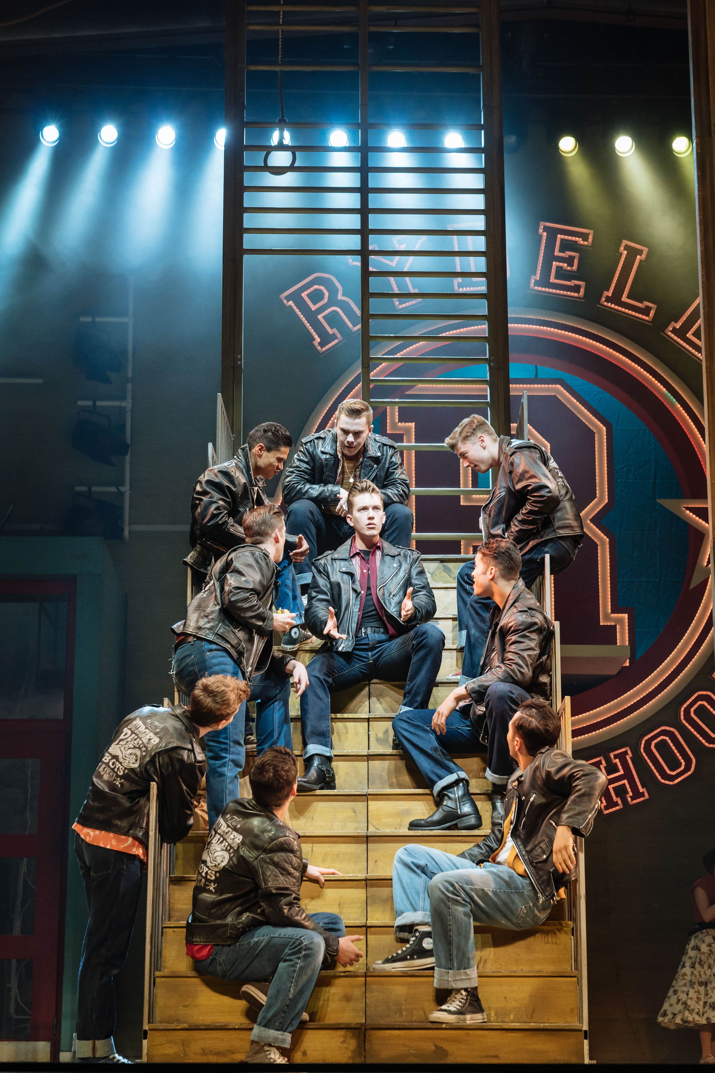 Dan Partridge as Danny (centre) and the T-Birds in the UK and Ireland tour of GREASE, credit Manuel Harlan.jpg