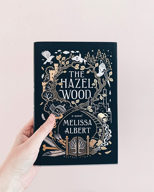 "Ready for my next read! I'm excited to start ""The Hazel Wood"" because it is so up my alley! Spooky Forests? Yes please! 🙋🏼‍♀️ ✨ So my last read was really disappointing. It was reviewed well, but for a YA fantasy it was simply bland - like every basic YA fantasy trope rolled into one book with no innovation. I was so surprised because it came out this year but it read like something from five years ago. All this is to say, you can't always trust a splashy marketing campaign and launch. ✨ What is your favorite book that has flown under the radar? If it's fantasy send it my way because I need a palate cleanser!"