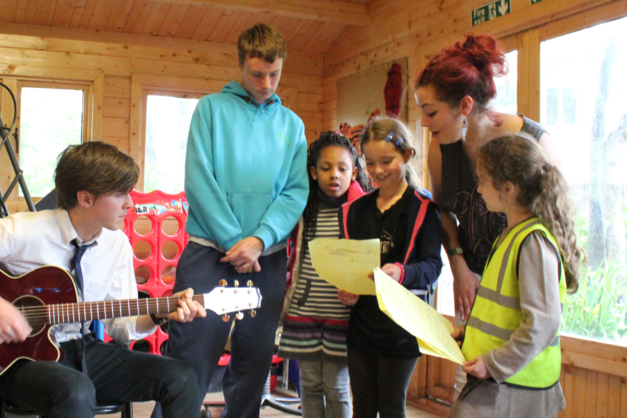 Danny, aged 16 helping with a visiting musicians workshop for the young people 2013