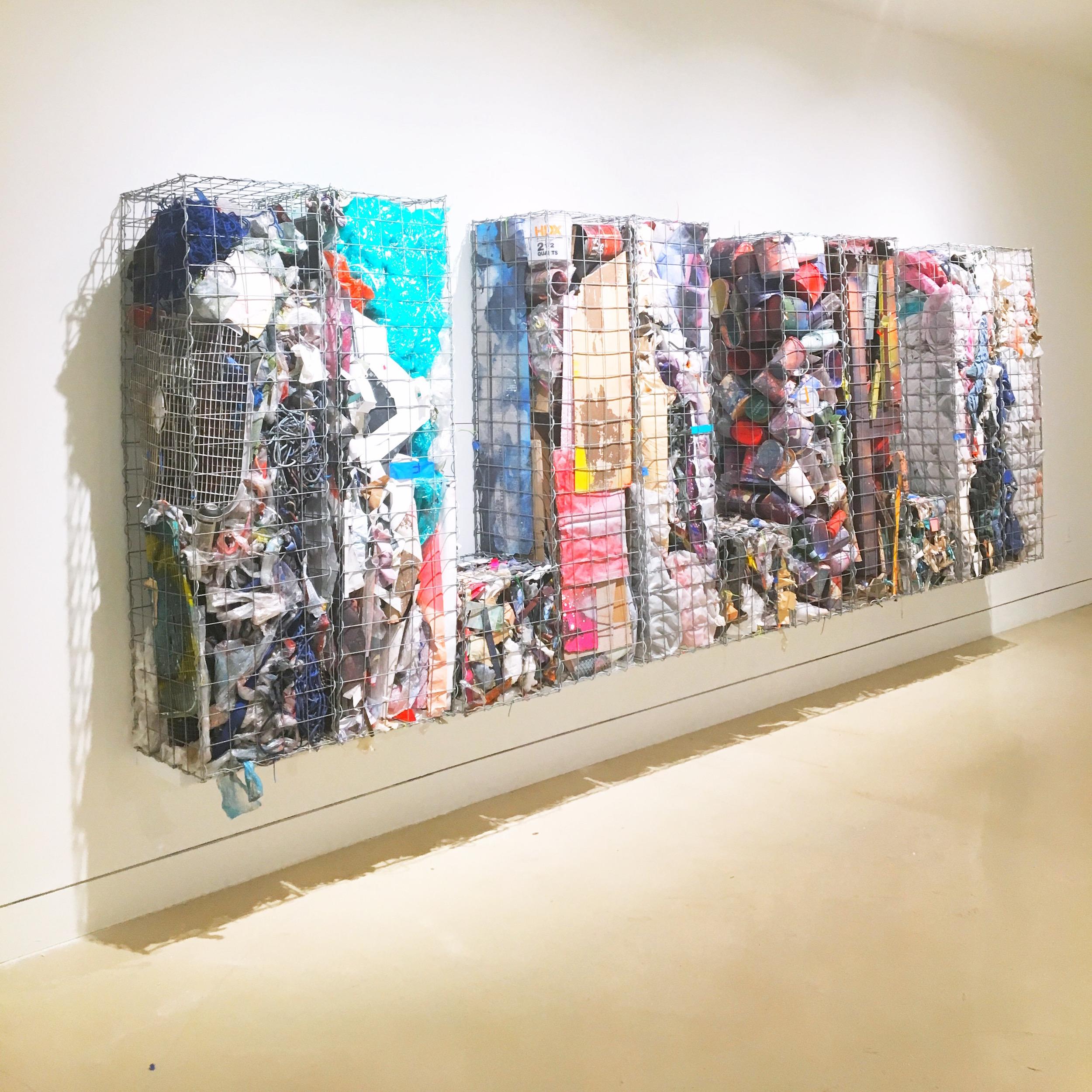 IAIN MUIRHEAD   18161:18172  , 2014-2018. Gabion baskets, zip ties, aggregate studio material. 60 x 174 x 16 inches. Installation view Torrance Art Museum.