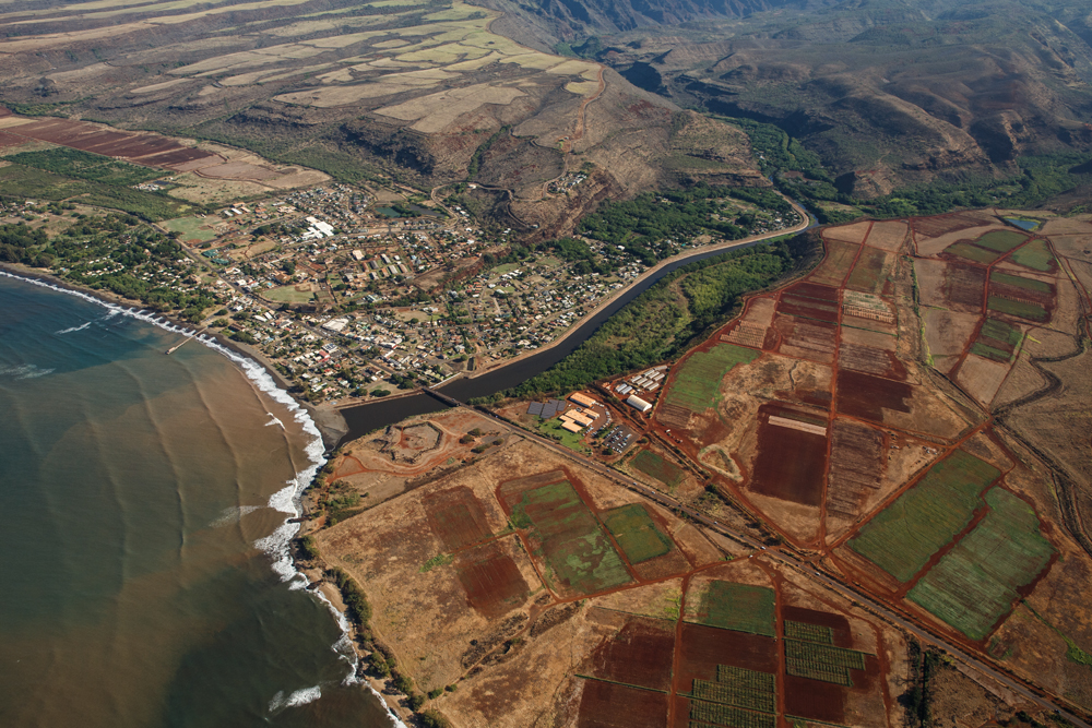 An aerial shot of GMO research fields upwind from the west Kaua`i town of Waimea.  Photo credit: Makana Designs