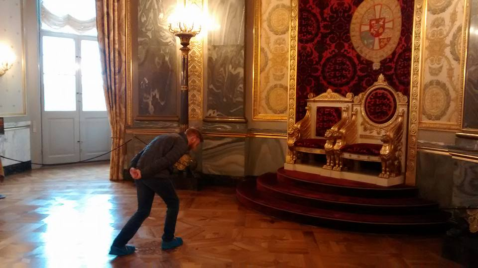 Andy showing proper respect for royalty that no one shows anymore. Also, notice his neat booties you have to wear to keep the floors nice.