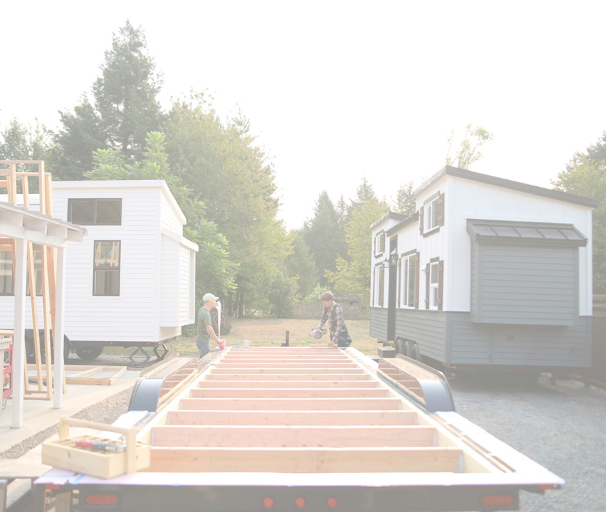 Oceanside - $76,000Oceanside, the latest tiny home model from Handcrafted Movement. Now under construction with an expected completion date of July 20th. At 30' x 8.5' this tiny home will feature a downstairs bedroom as well as a full size loft with stairs. The exterior will be all white with black windows and a black metal roof. Additional features are built in air conditioning, and a exterior cedar deck system. Stay tuned for more details!