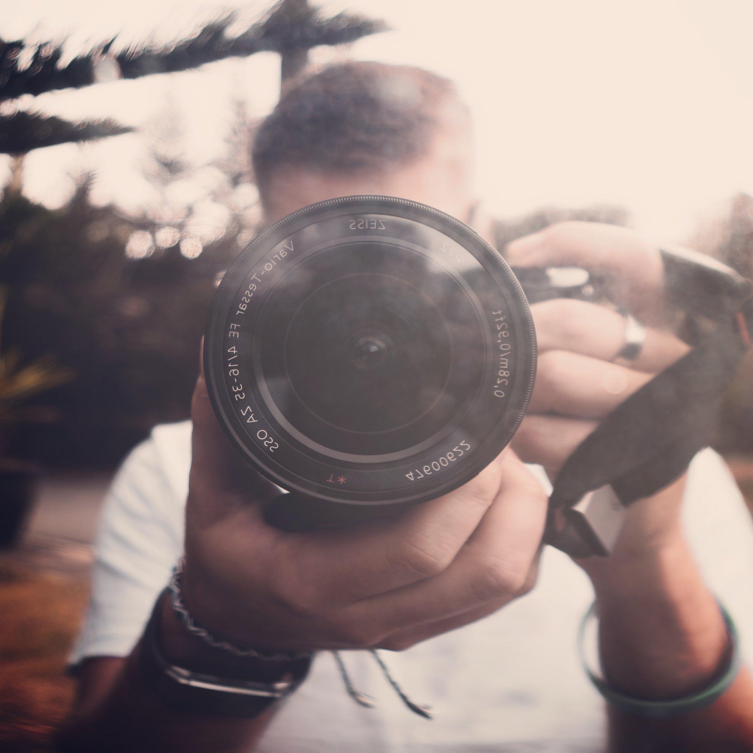 A photo of Sam taking a photo of Sam taking a photo