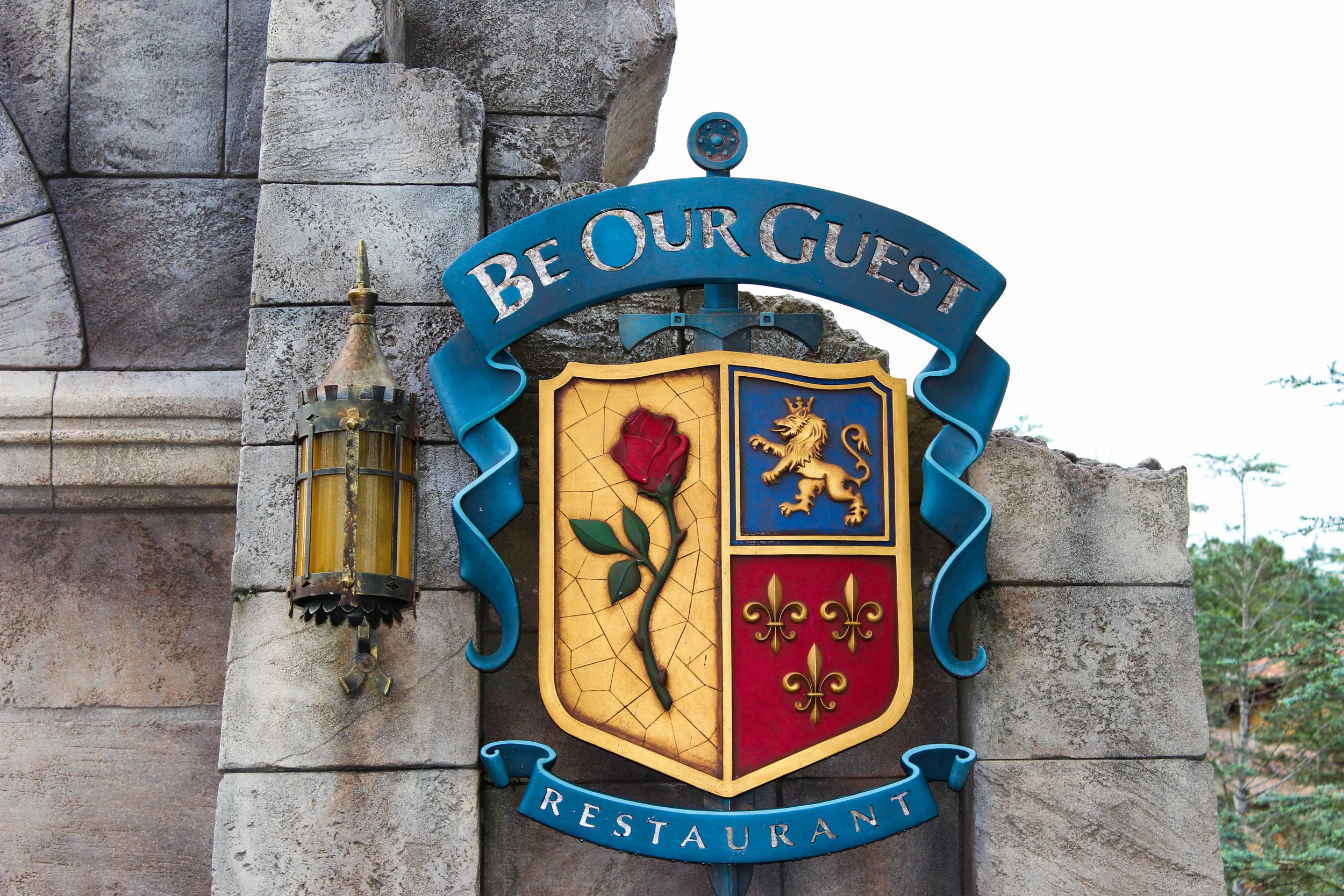 Exterior sign at the Be Our Guest Restaurant.