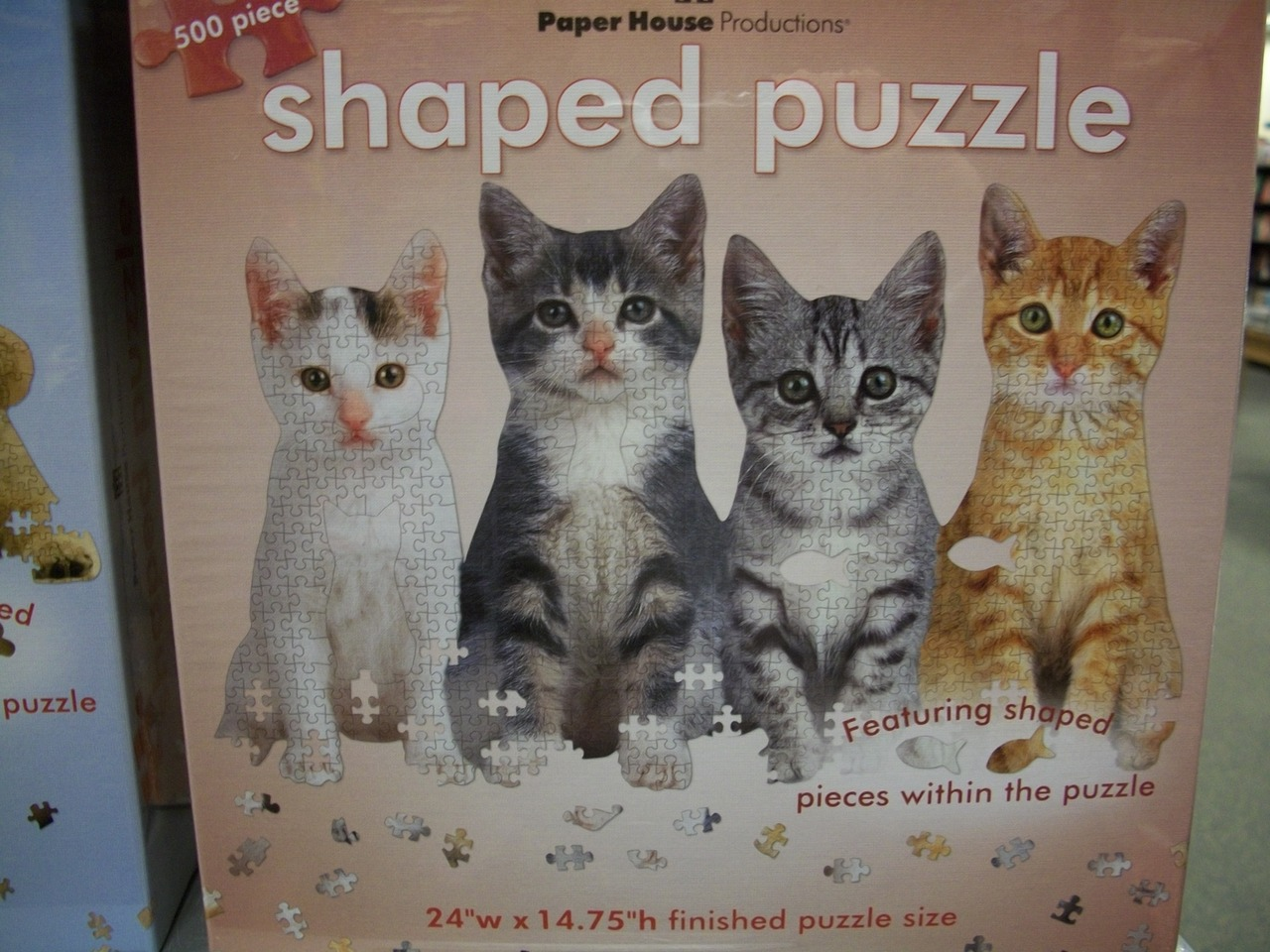 Cat people of Tumblr, this puzzle is insane: it's in the shape of fish puzzle pieces, and the result? KITTIES!