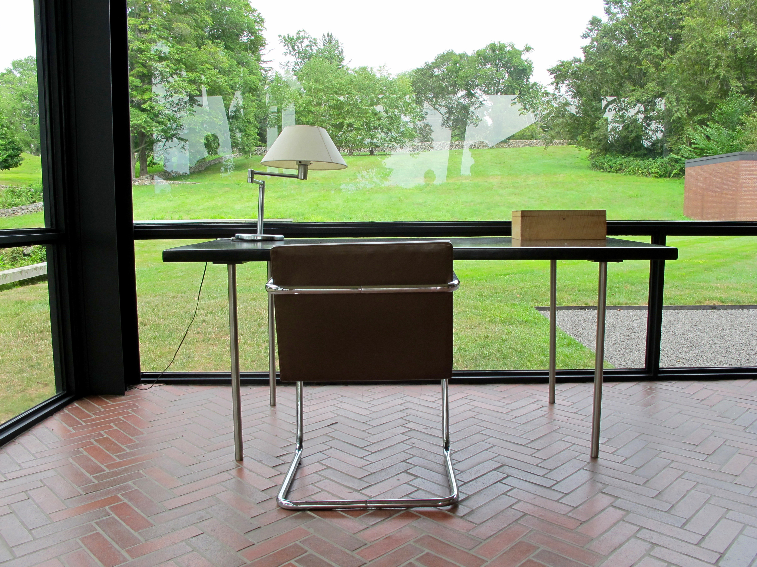 The Study:  Ludwig Mies van der Rohe Writing table, 1930; Ludwig Mies van der Rohe Brno tubular chair, 1929; Walter von Nessen Swing-arm table lamp, 1927