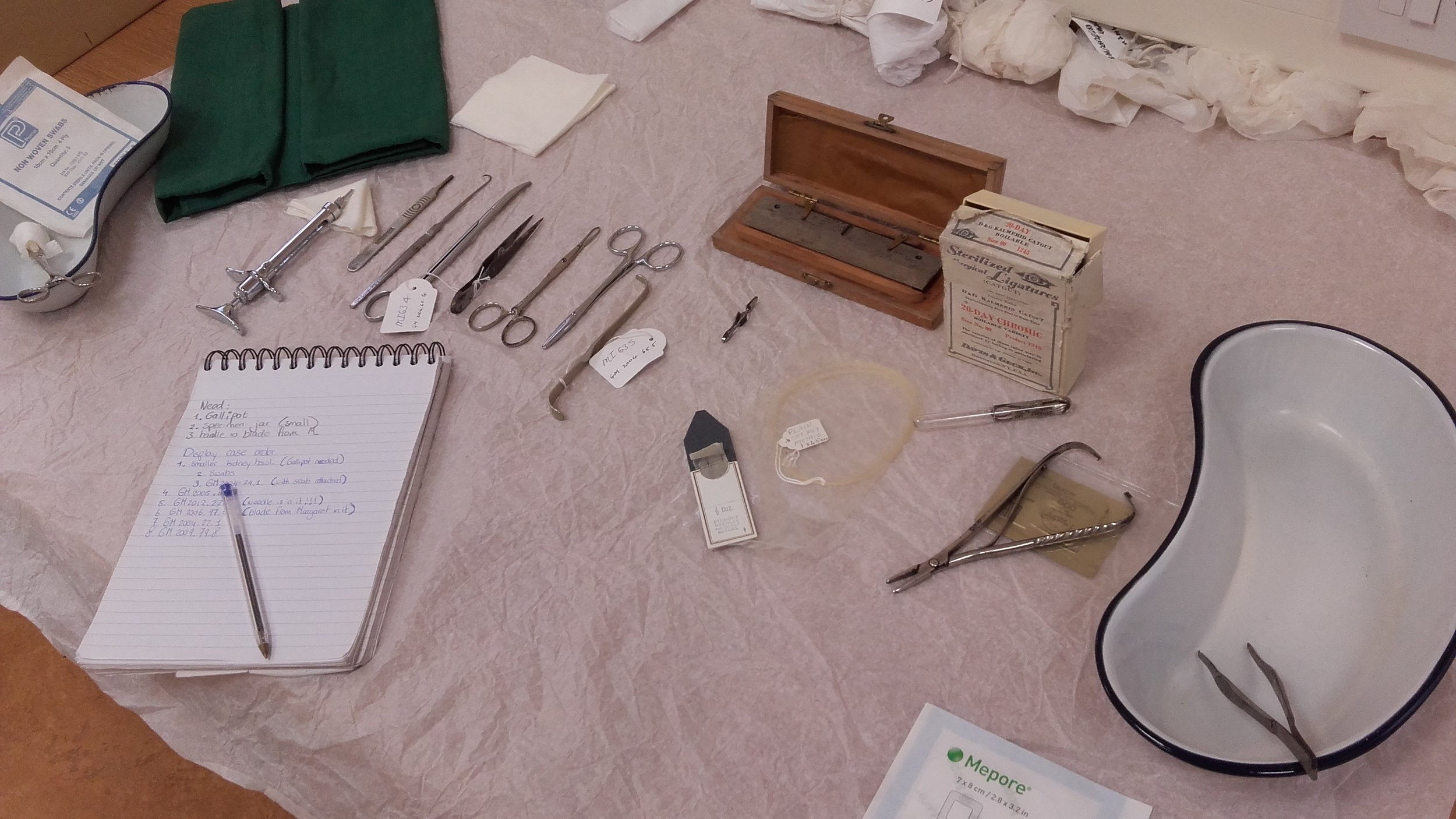 Various surgical tools and other items.