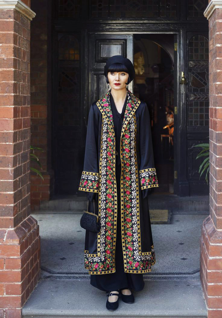 Essie Davis as Fryne Fisher wearing an embroidered coat