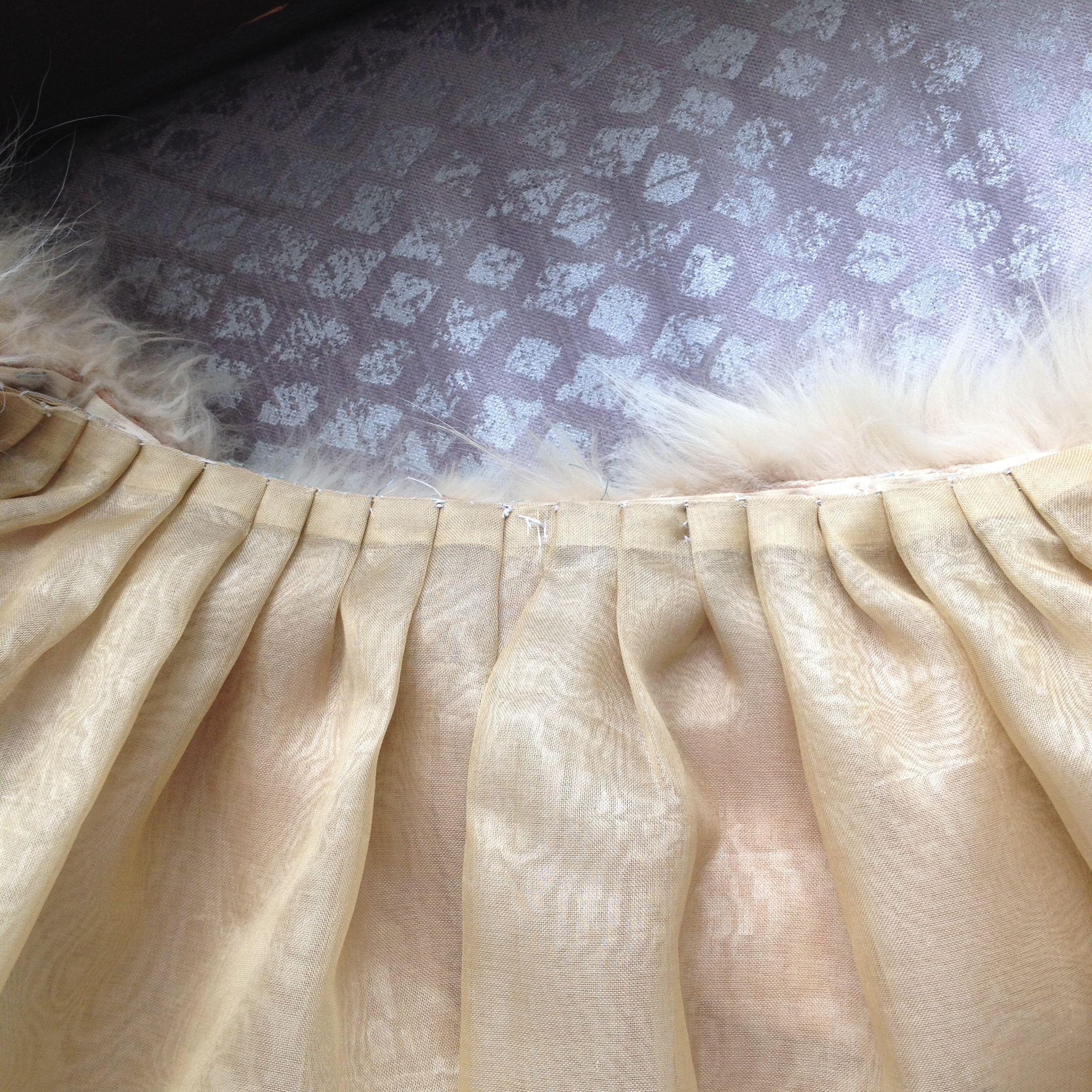 Pleats pressed and stitched down flat