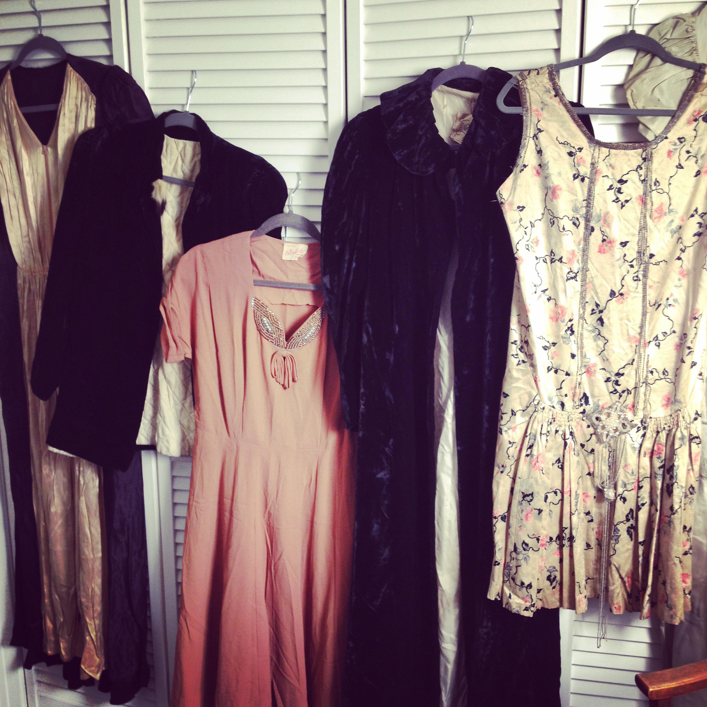 Here is part of the collection of vintage dresses and coats that I was gifted.  The dress I used is on the far left.