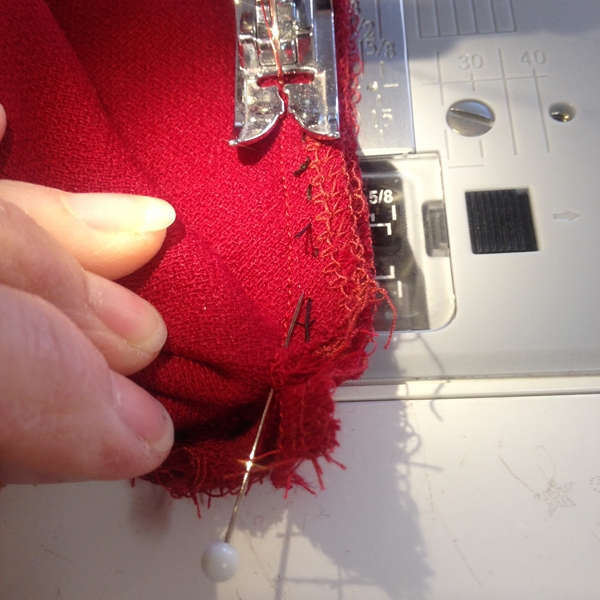 6. Stitch together along the stitch line ending at the v point, precisely and taking the pins out as you go.