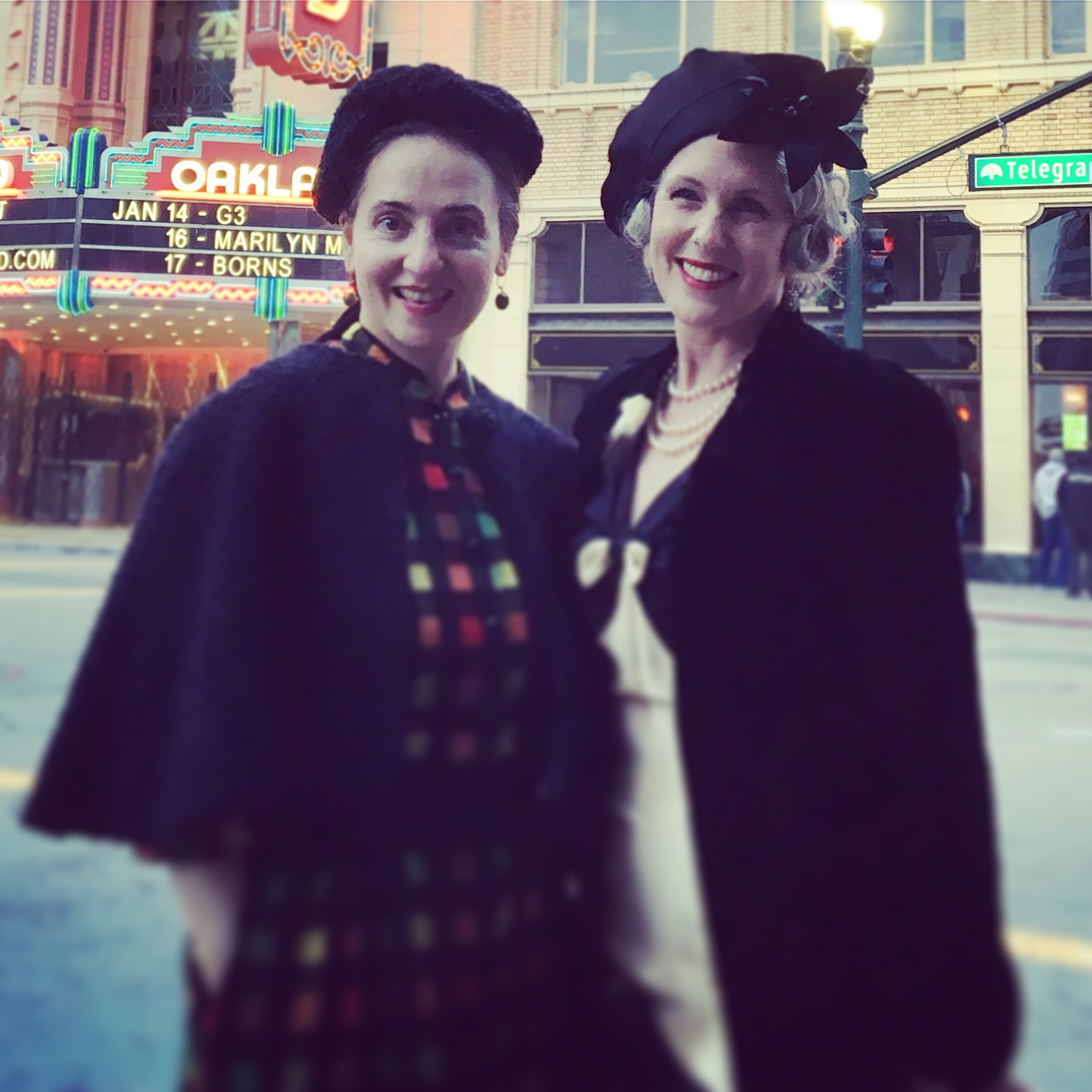 Here I am wearing the coat, pictured next to my friend Leah Vass, in front of the Fox Theater in Downtown Oakland.  It did not have a lining in it - Such a risk!