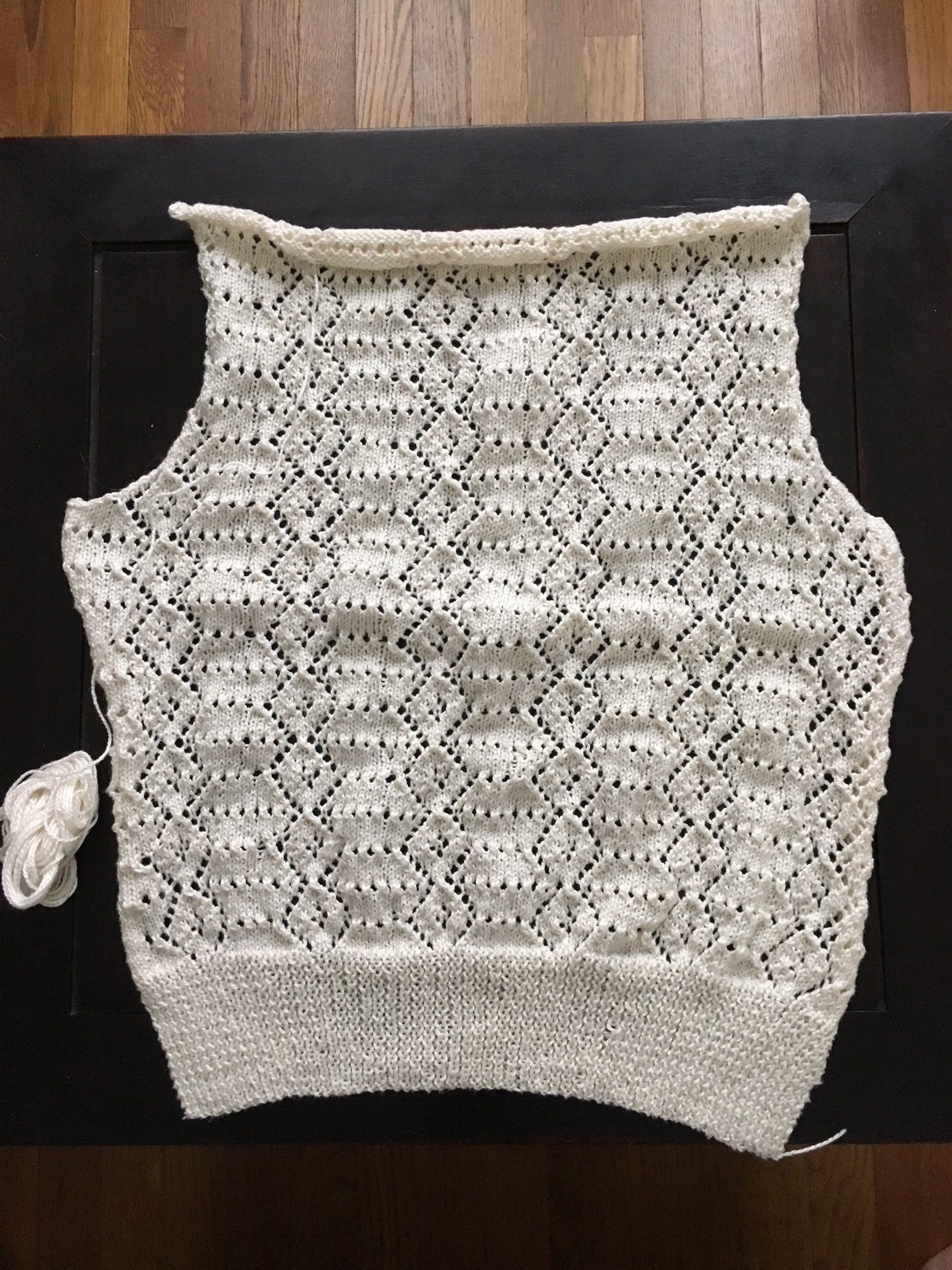 Here is the back finished.  I was able to knit it using not quite a whole skein, so that meant that I only had two ends to weave in.