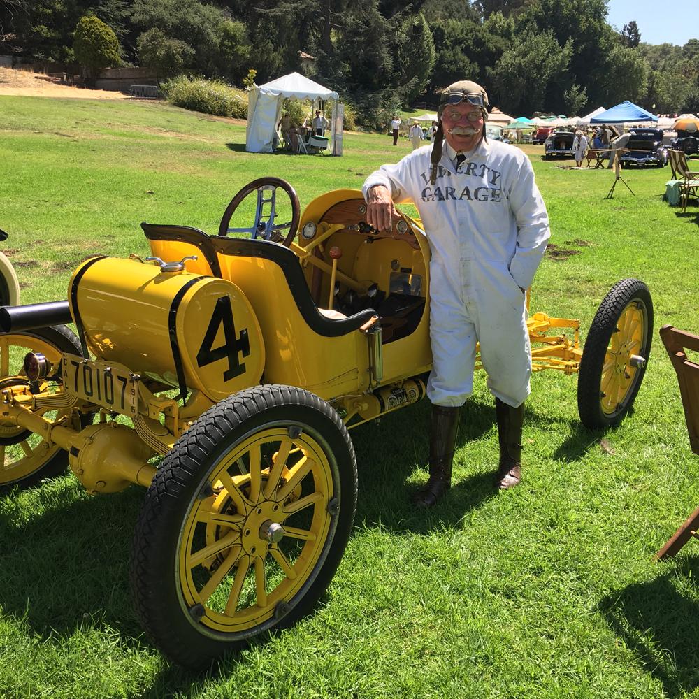 A dapper gentleman and his race car
