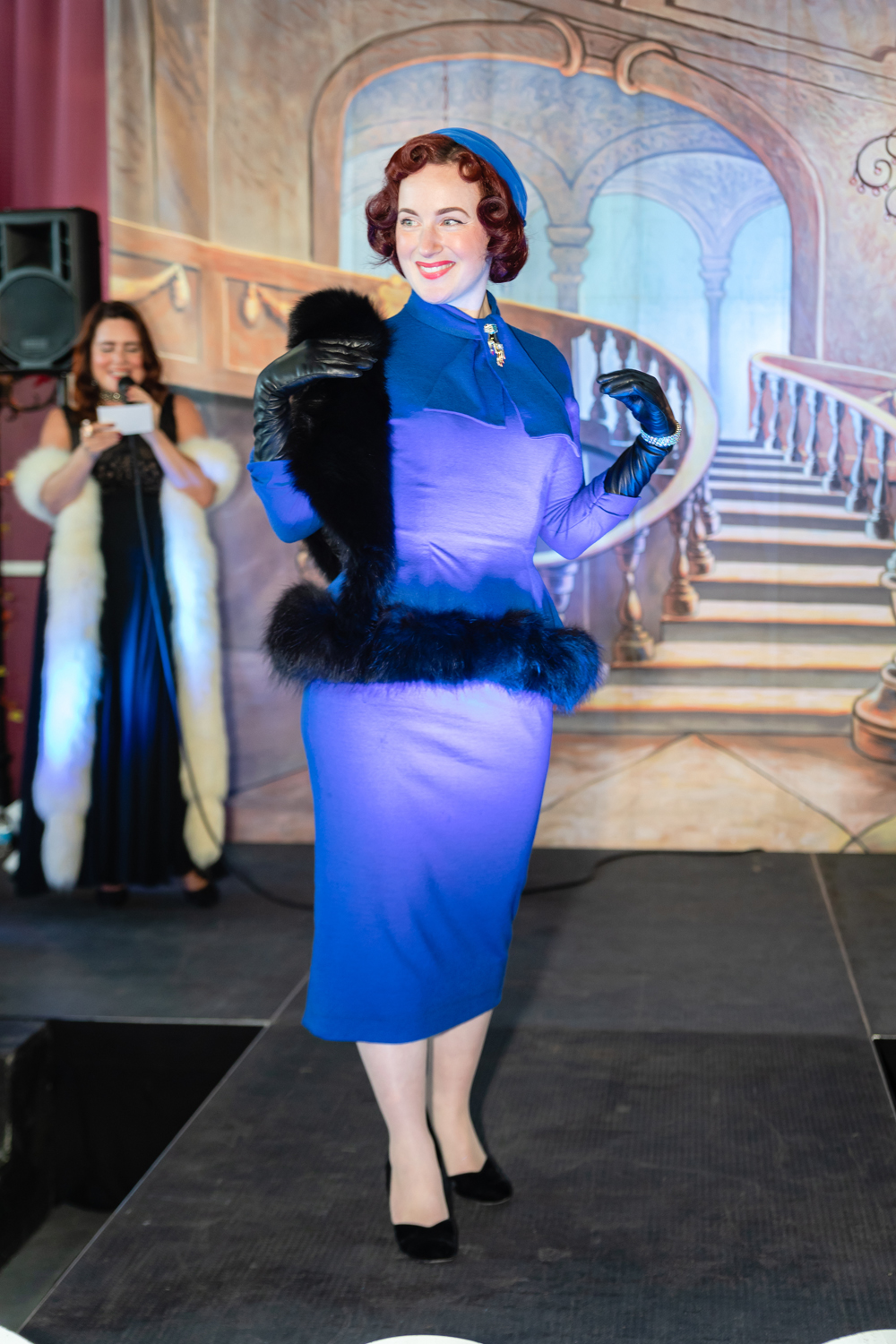 Straight out of Mad Men, she (AKA @dee2the9s on insta) stepped onto the stage. My goodness, this cobalt blue suit with fur trim and matching hat was out-of-this-world!