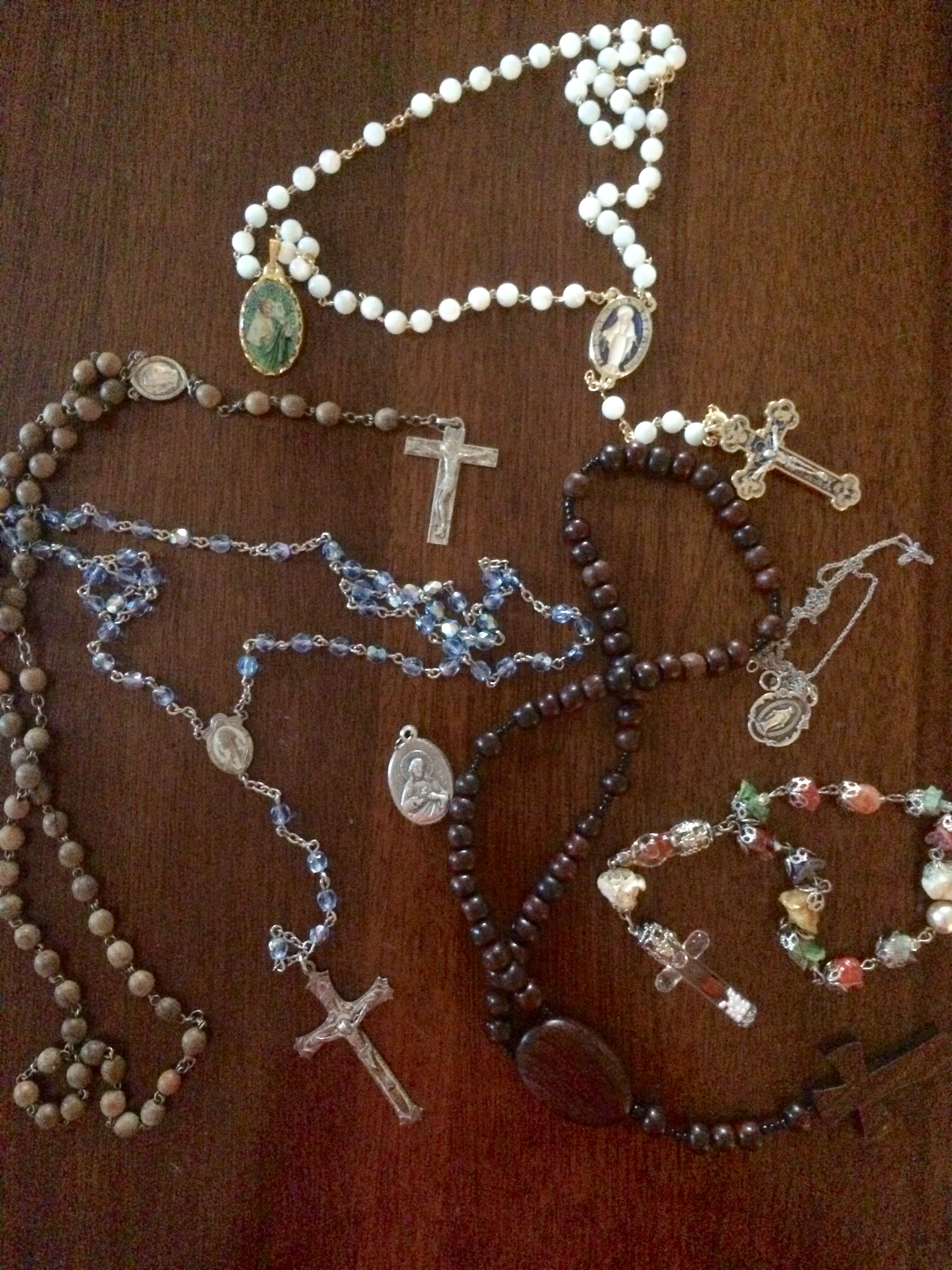 My collection of rosaries and medals. You can't take the idolatry out of the Catholic girl, no matter how much she questions the doctrine of her security blanket. So pretty...