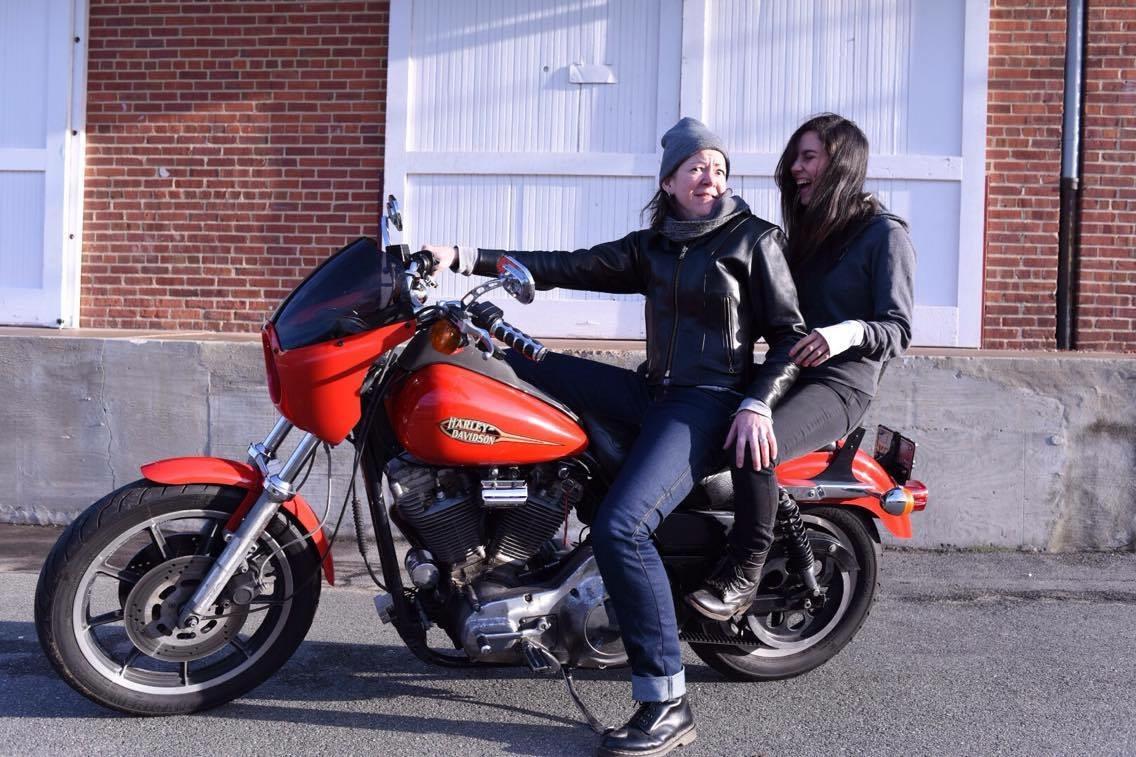 Worse for Wear founder and designer, Laura Smith (left) on a big ol' orange Harley