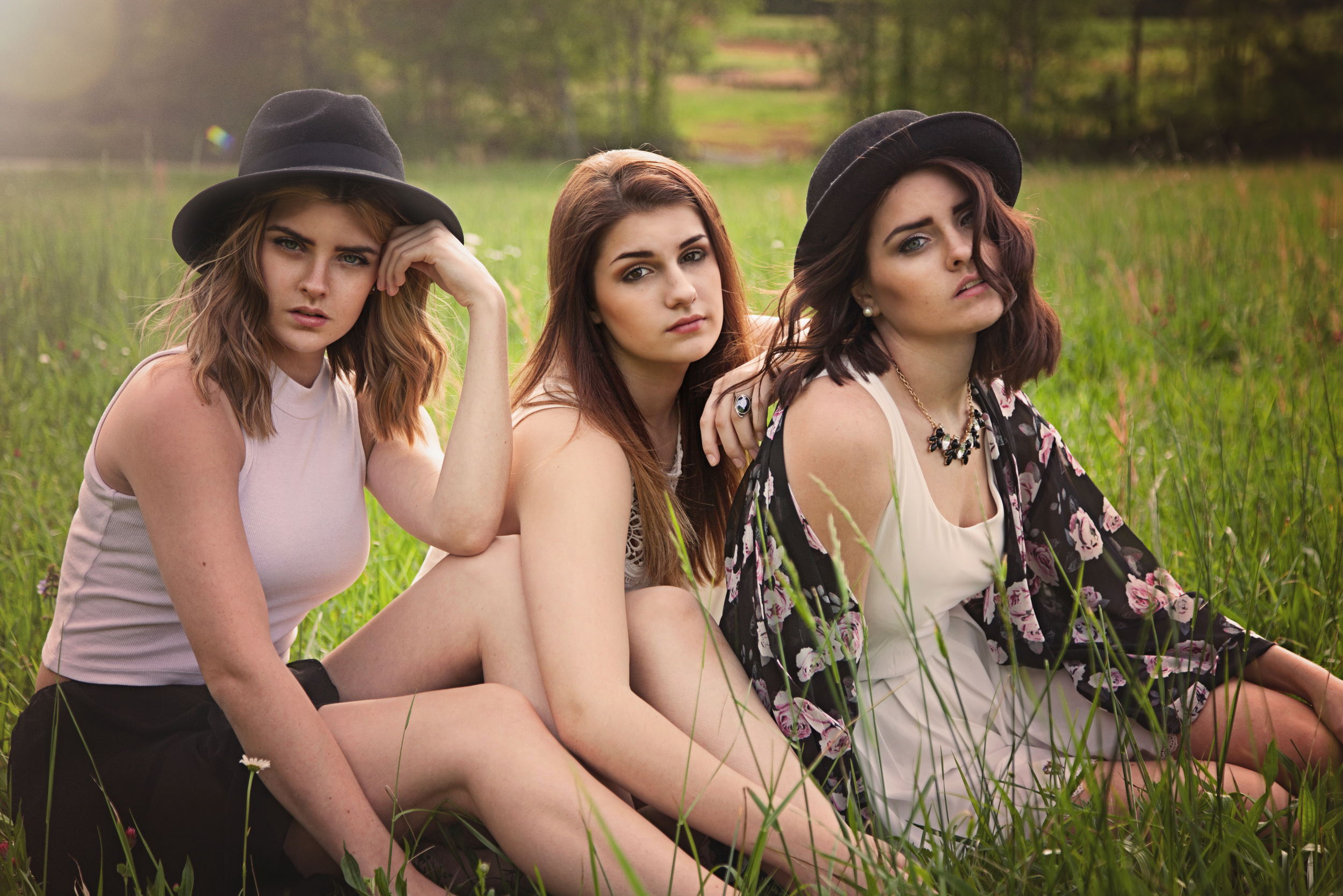 sisters seniors outside outdoor women young ladies atlanta marietta portrait photographer styled boho field meadow