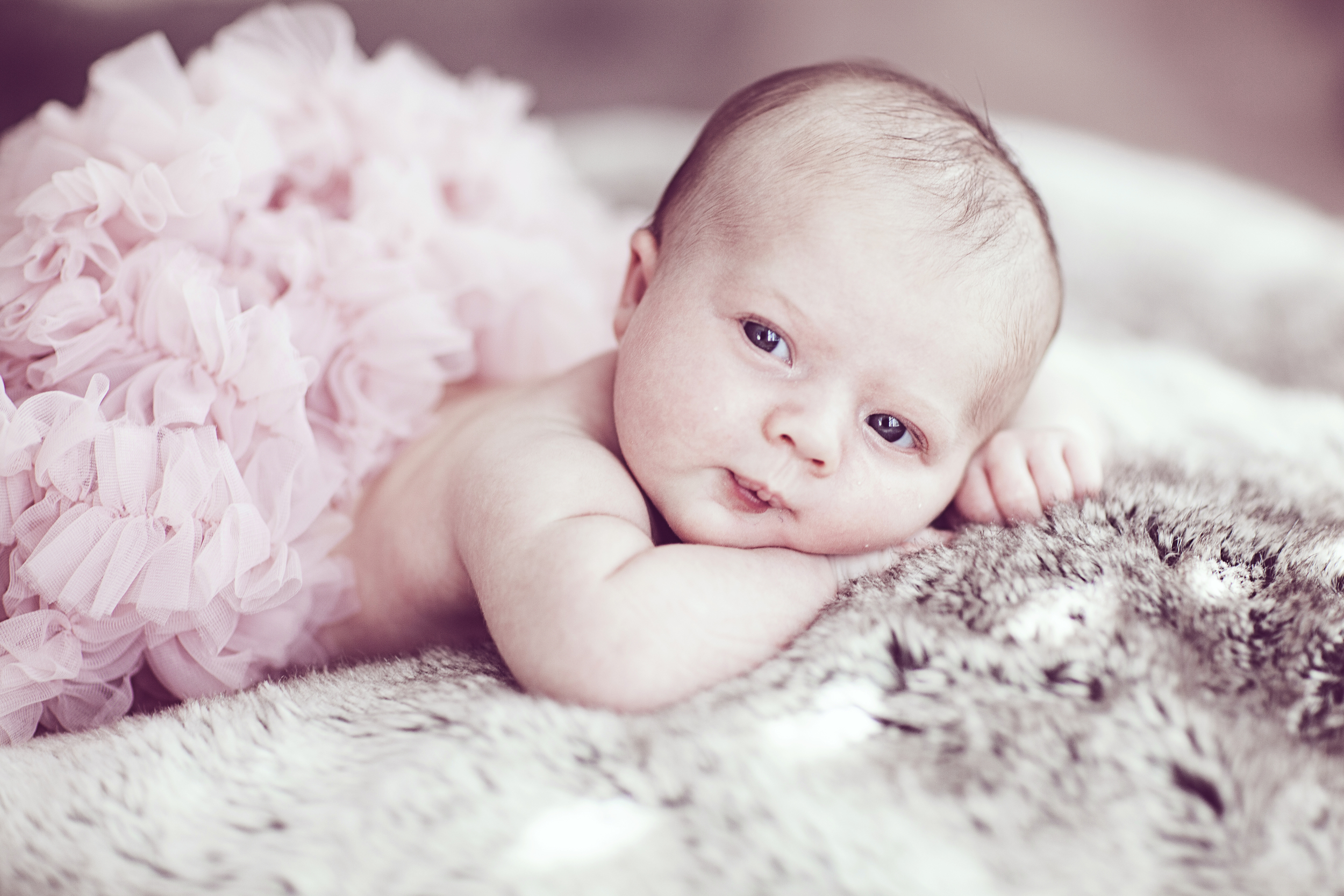 baby blue eyes sweet newborn lady girl tutu frilly pink cute smile soft portrait pose fingers atlanta