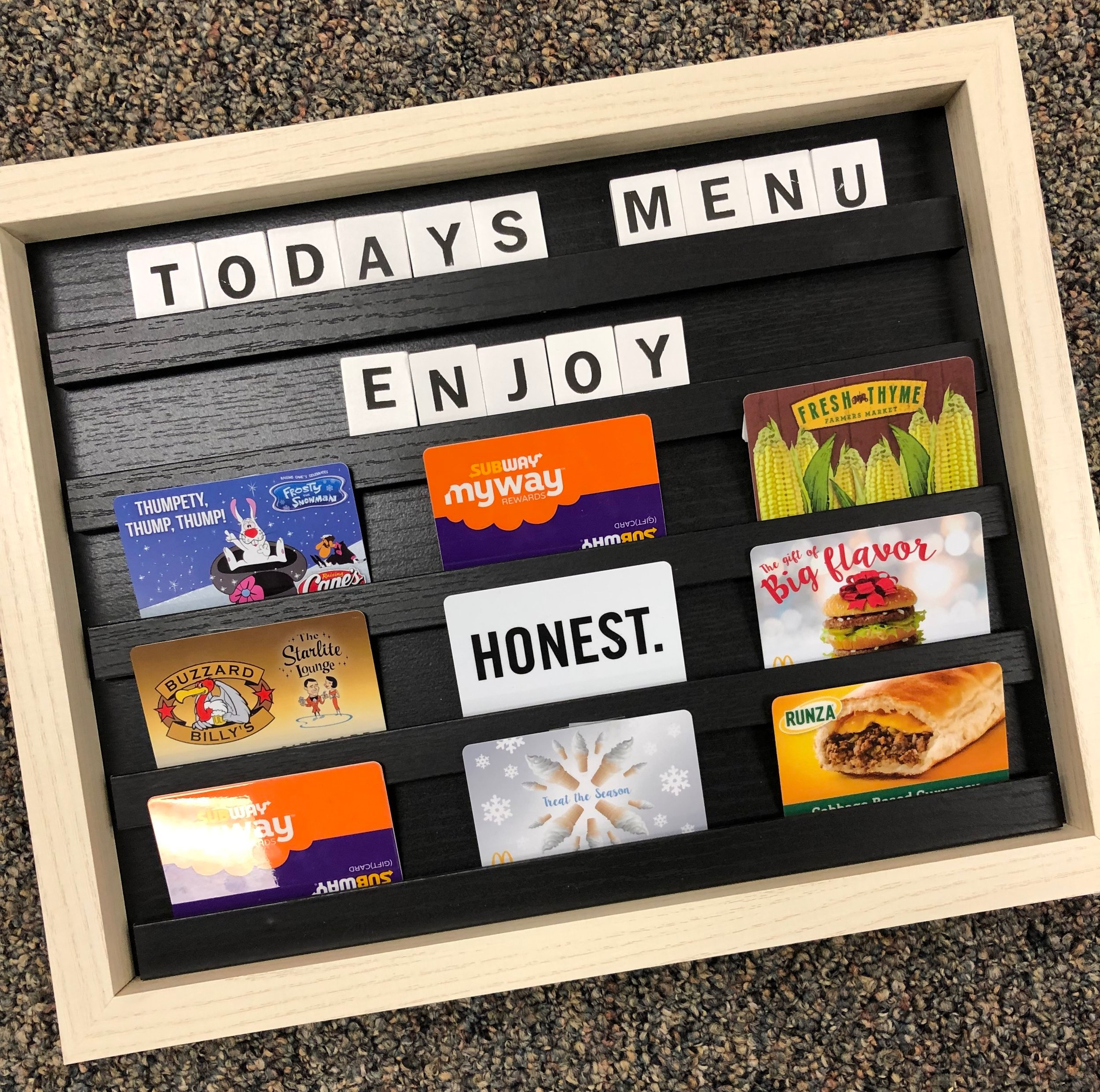 Dinner on the go. - Low on groceries? Short on time? Just plain tired? This cute message board comes filled with gift cards to keep your family fed.