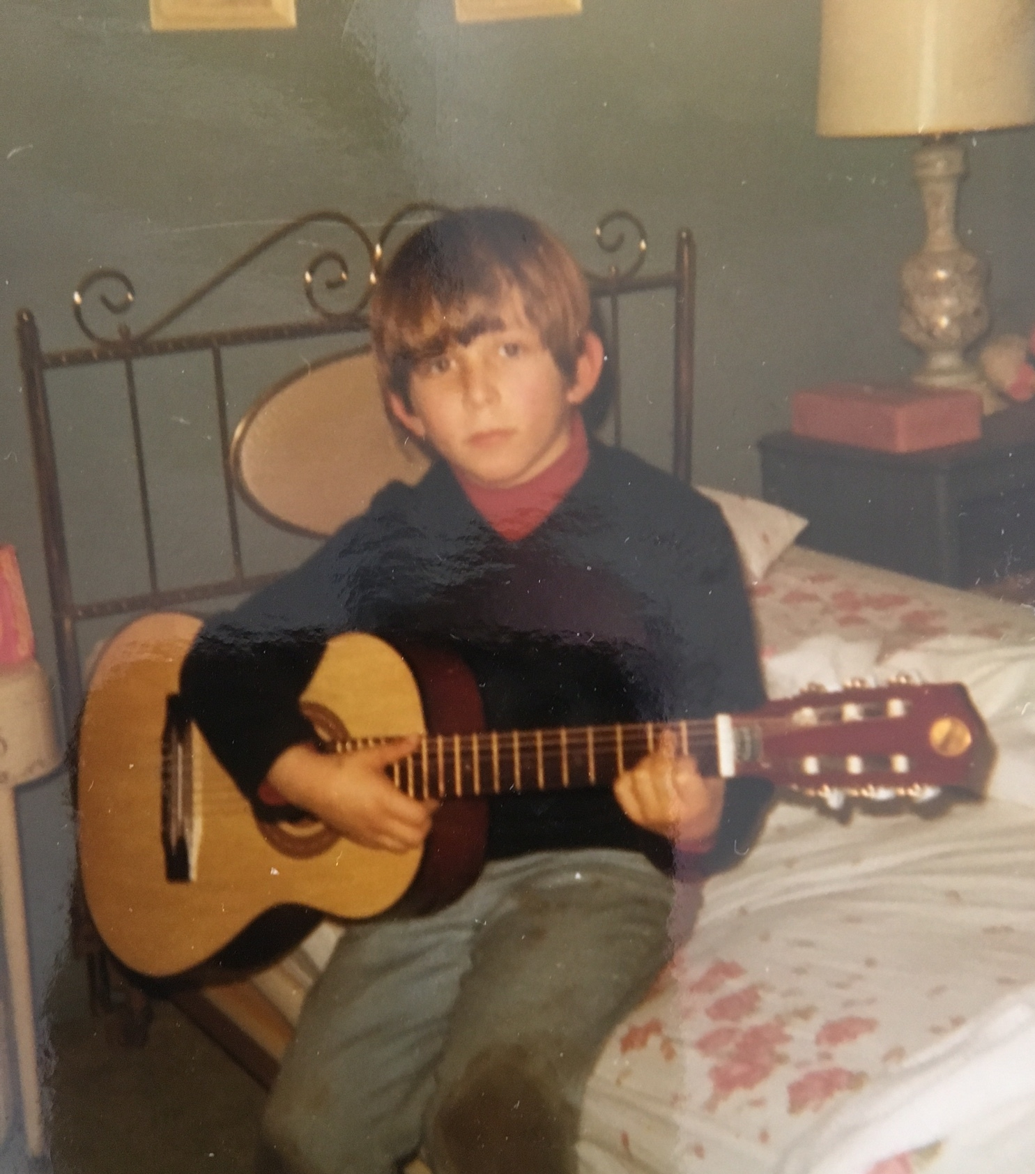 Roger gets his start on guitar. He's now a successful musician!