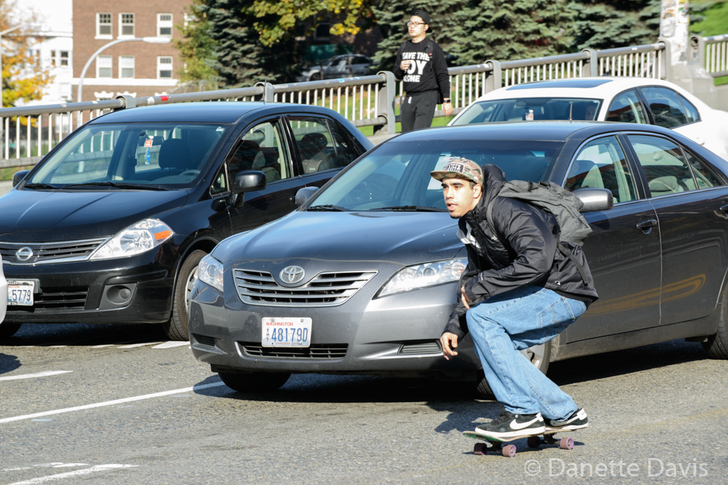 Sometimes the unexpected shot occurs. The skateboarder didn't notice the officer in the car next to him.   Seattle