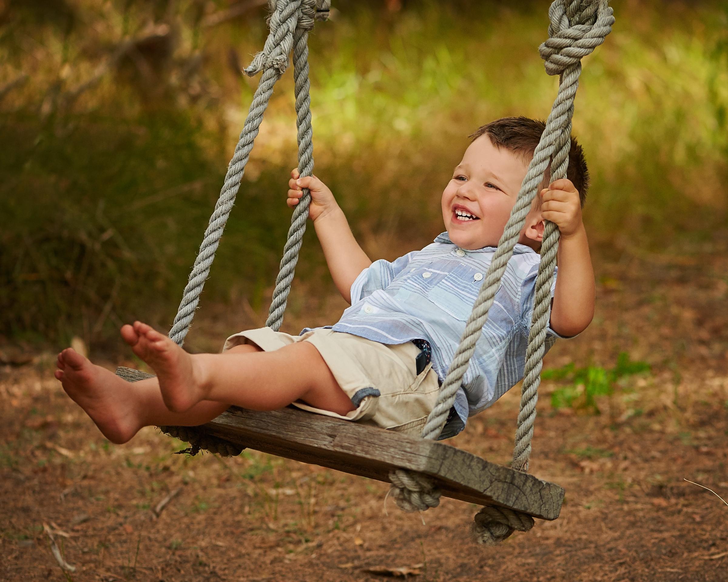 laughing swing kids