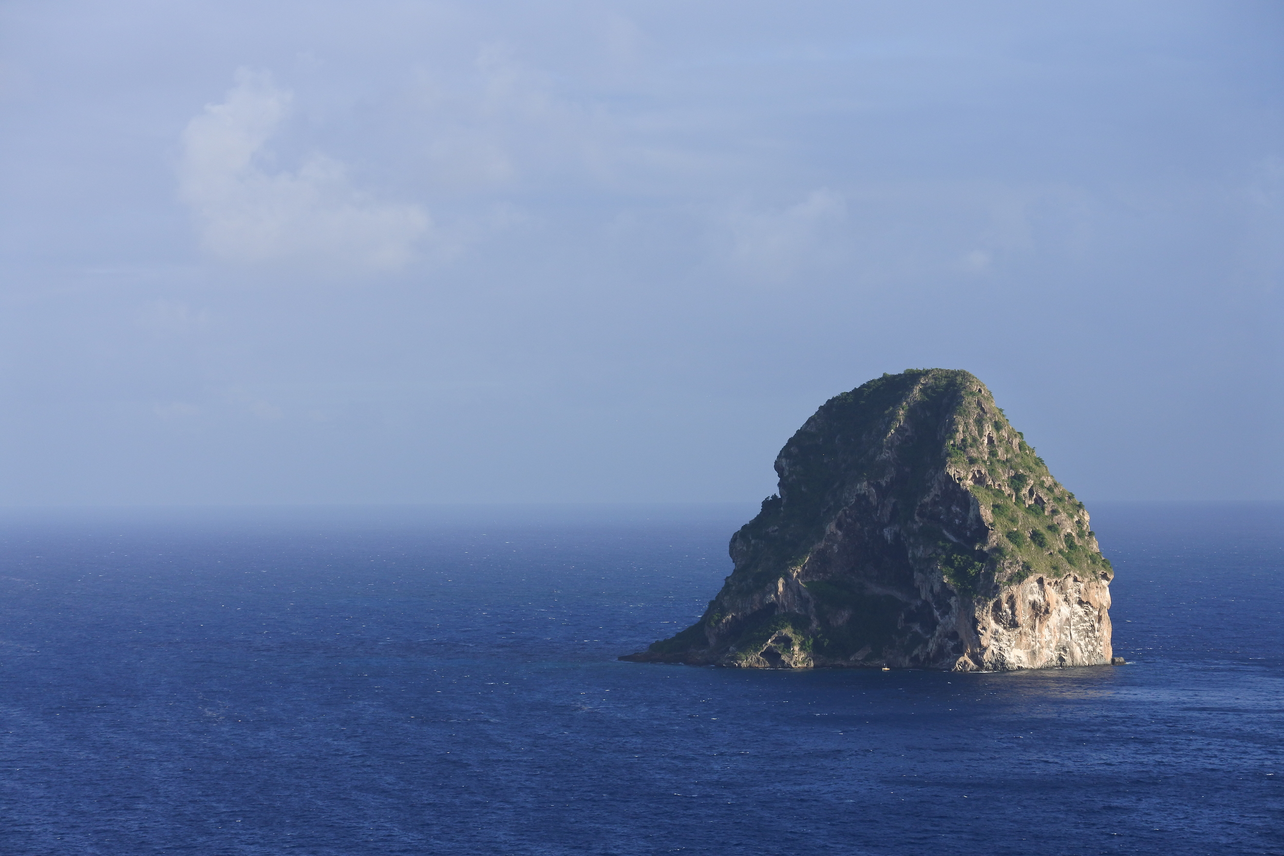 Diamond Rock, sits ominously off the coast of Le Diamant like the lair of a Bond film villain.