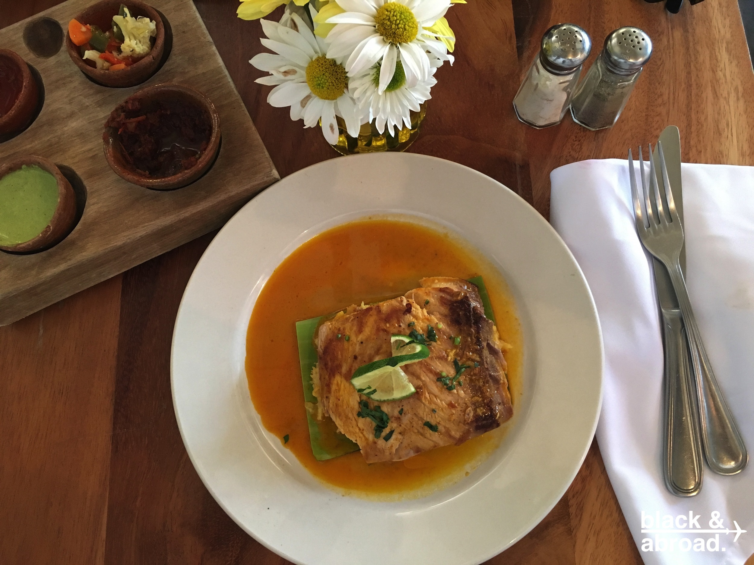 The Pescado Garifuna - Seared Mahi Mahi served atop a green plantain tamale with a coconut based tomato sauce.