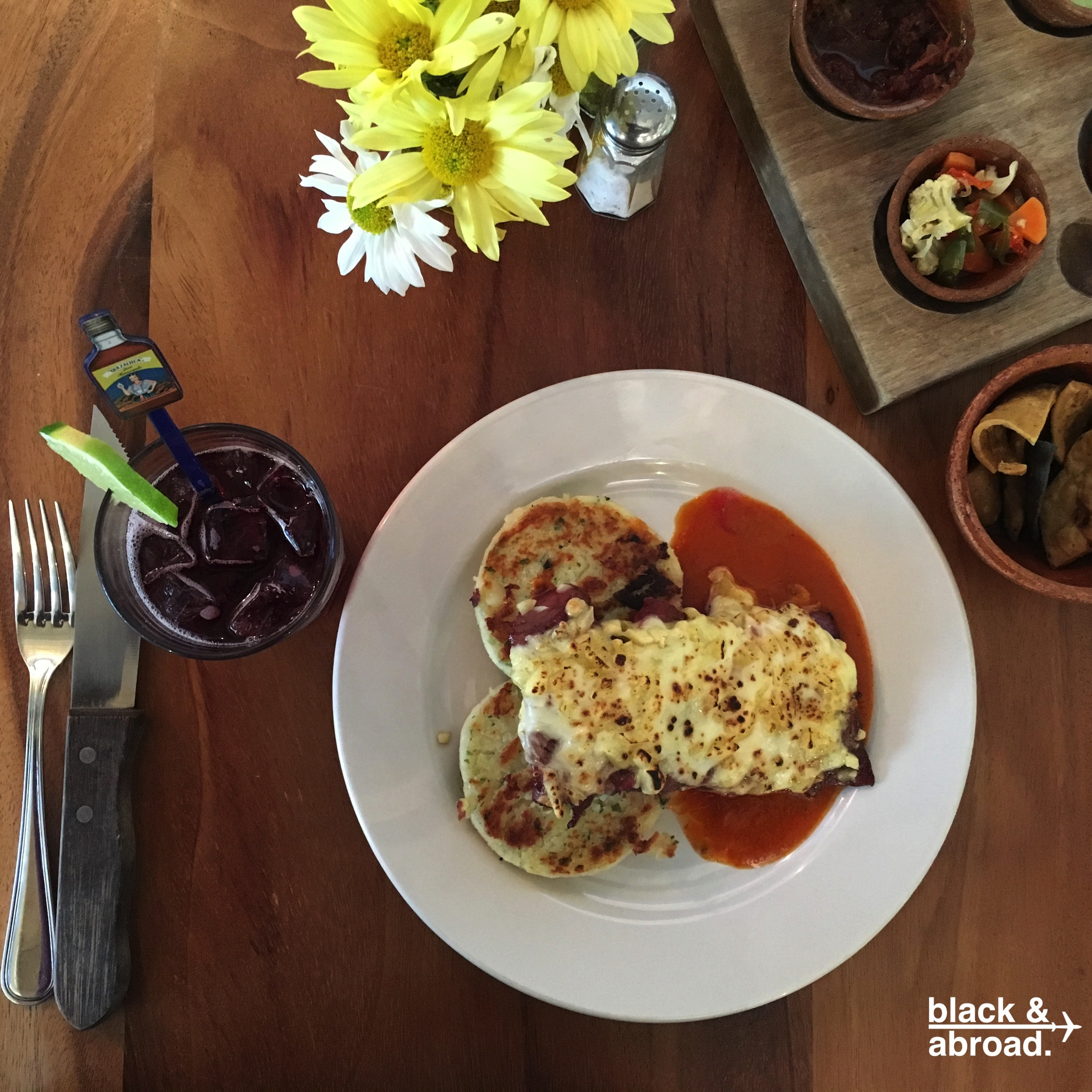 The Lomito Viajero - grilled beef tenderloin served with chancol cheese, a spicy red sauce and potato cakes.
