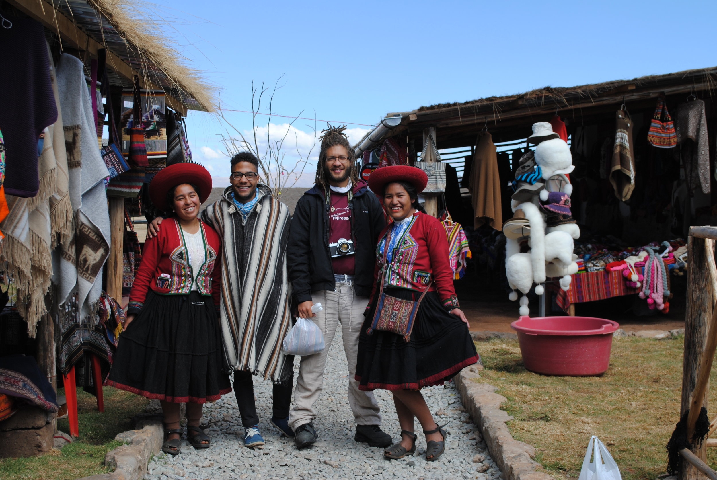 My younger brother and me making new friends in Peru - looks like a family photo.