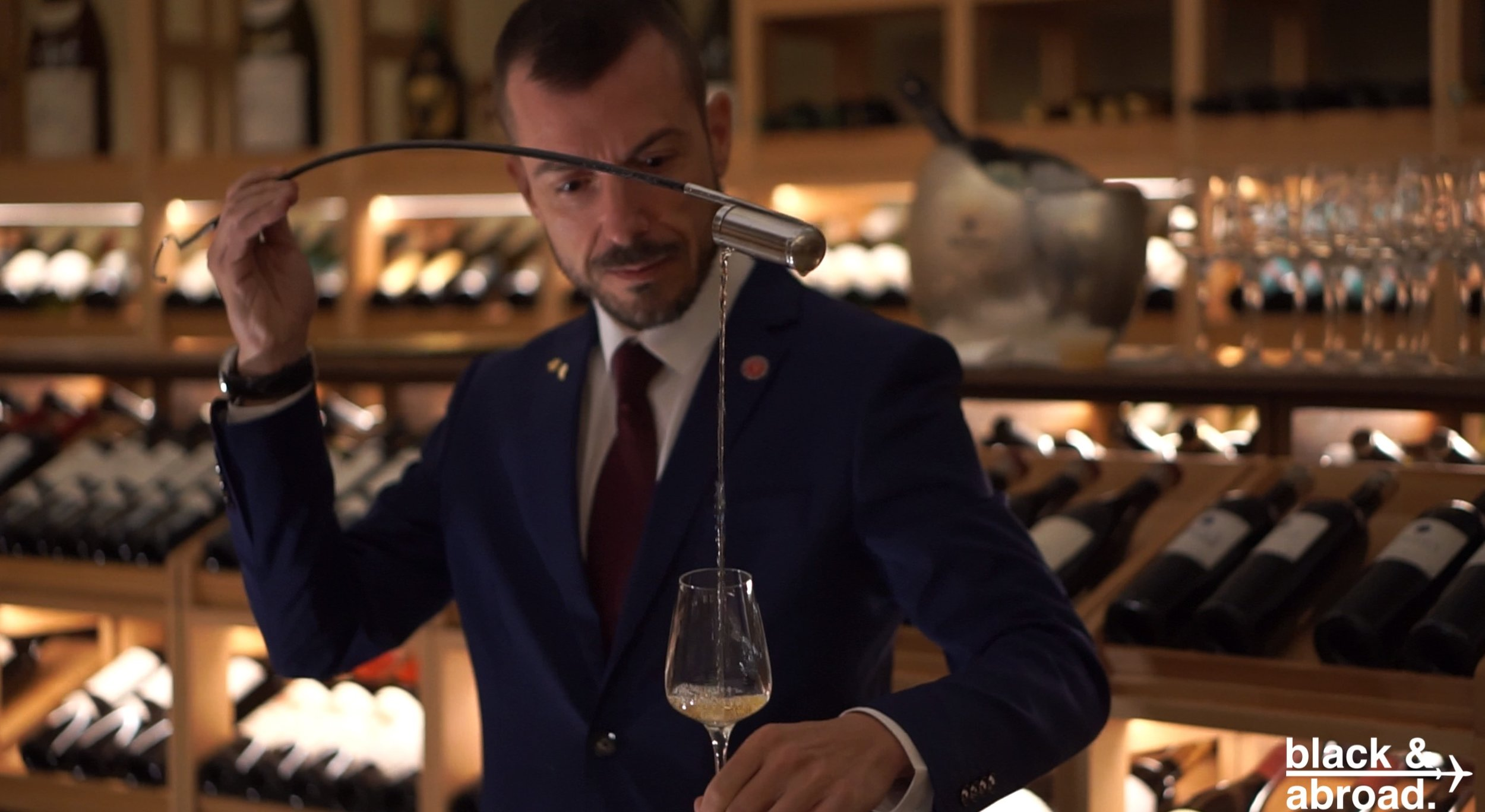 One of Coque's sommeliers aerating the wine pairing for starter #3.